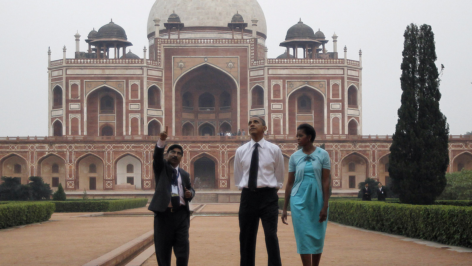 U.S. President Barack Obama and first lady Michelle Obama tour Humayun's tomb with their guide K.K. Muhammed in New Delhi November 7, 2010.
