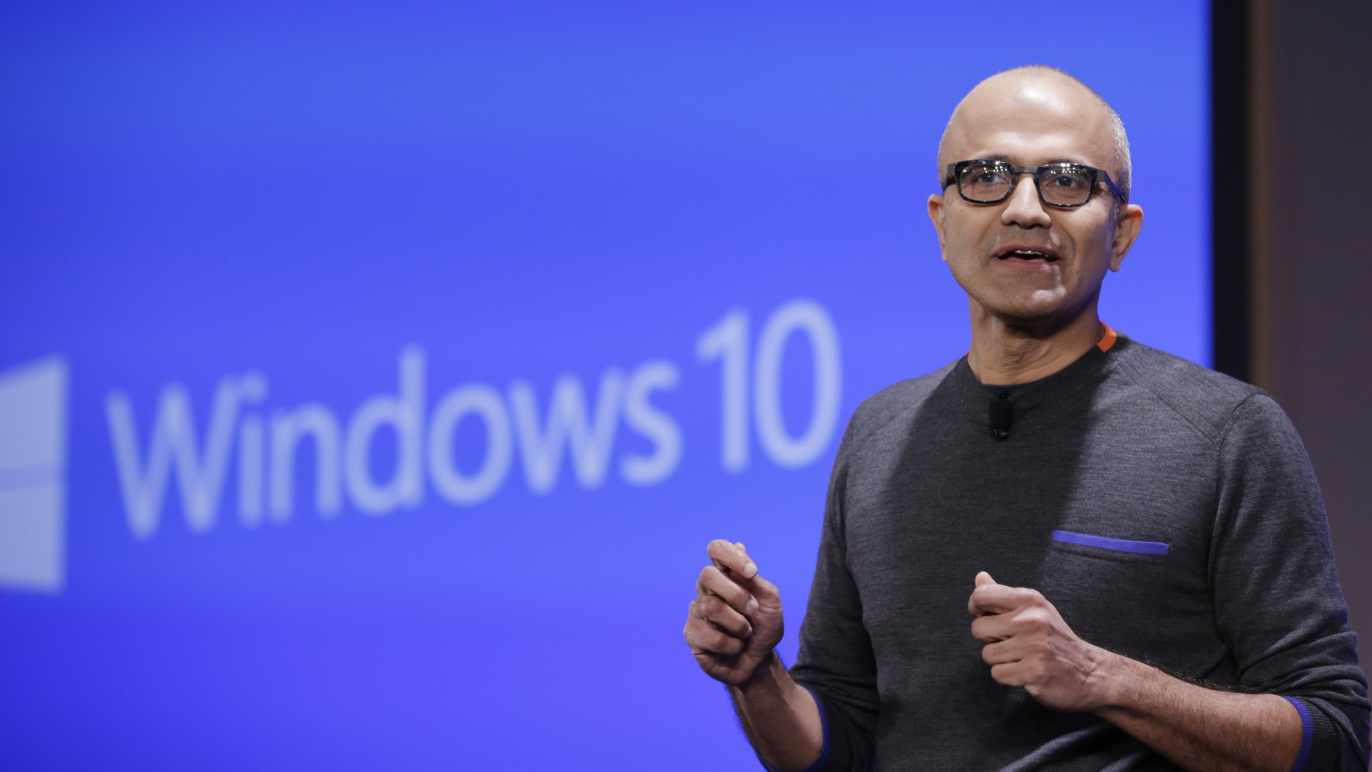 Microsoft CEO Satya Nadella speaks at an event demonstrating new features of its flagship operating system Windows at the company's headquarters Wednesday, Jan. 21, 2015, in Redmond, Wash. Executives demonstrated how they said the new Windows is designed to provide a more consistent experience and a common platform for software apps on different devices, from personal computers to tablets, smartphones and even the company's Xbox gaming console. (AP Photo/Elaine Thompson)