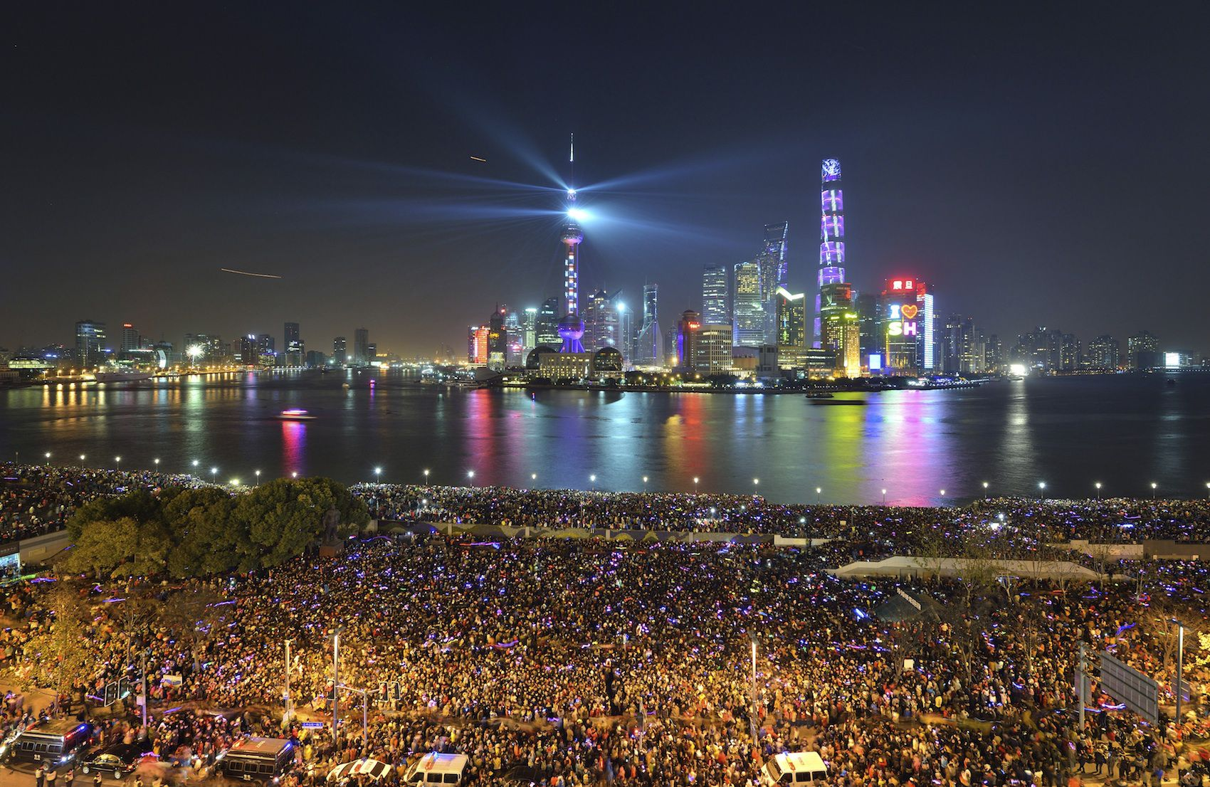 People watch a light show before a stampede incident occurred at the New Year's celebration on the Bund, a waterfront area in central Shanghai December 31,