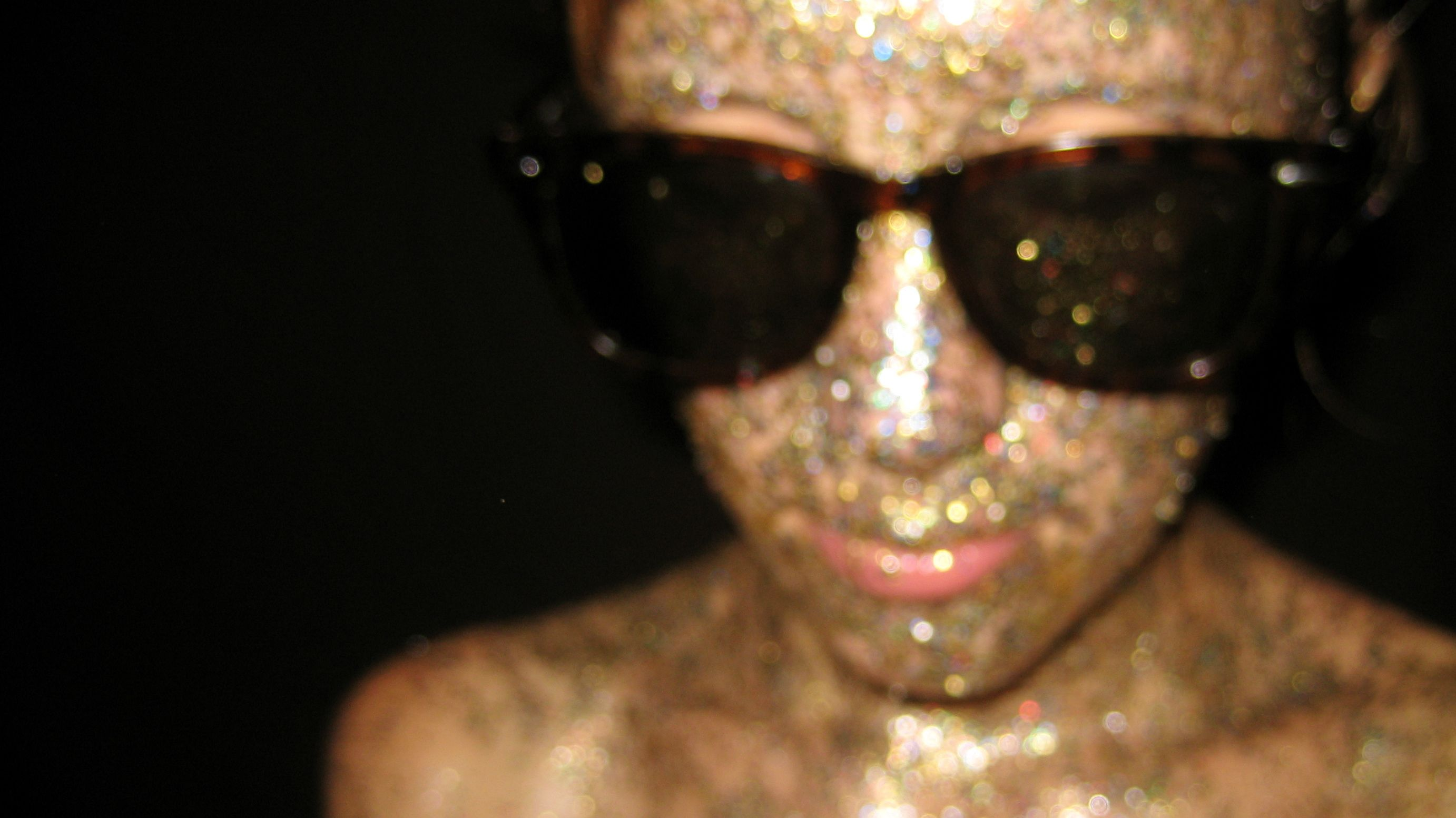 girl with glitter on her face.