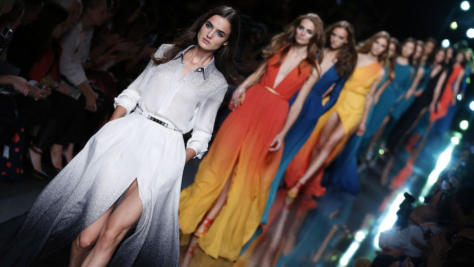 Models wear a creation for Elie Saab's Spring/Summer 2015 ready-to-wear fashion collection presented in Paris, France, Monday, Sept. 29, 2014. (AP Photo/Francois Mori)