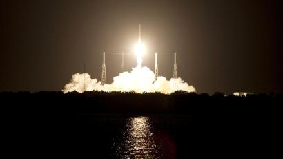 Space Launch Complex 40 is illuminated by a Falcon 9 rocket as it lifts off at 8:35 p.m. EDT carrying a Dragon capsule to orbit on Cape Canaveral Air Force Station in Florida, October 7, 2012. Space Exploration Technologies Corp., or SpaceX, built both the rocket and capsule for NASA's first Commercial Resupply Services mission to the International Space Station.