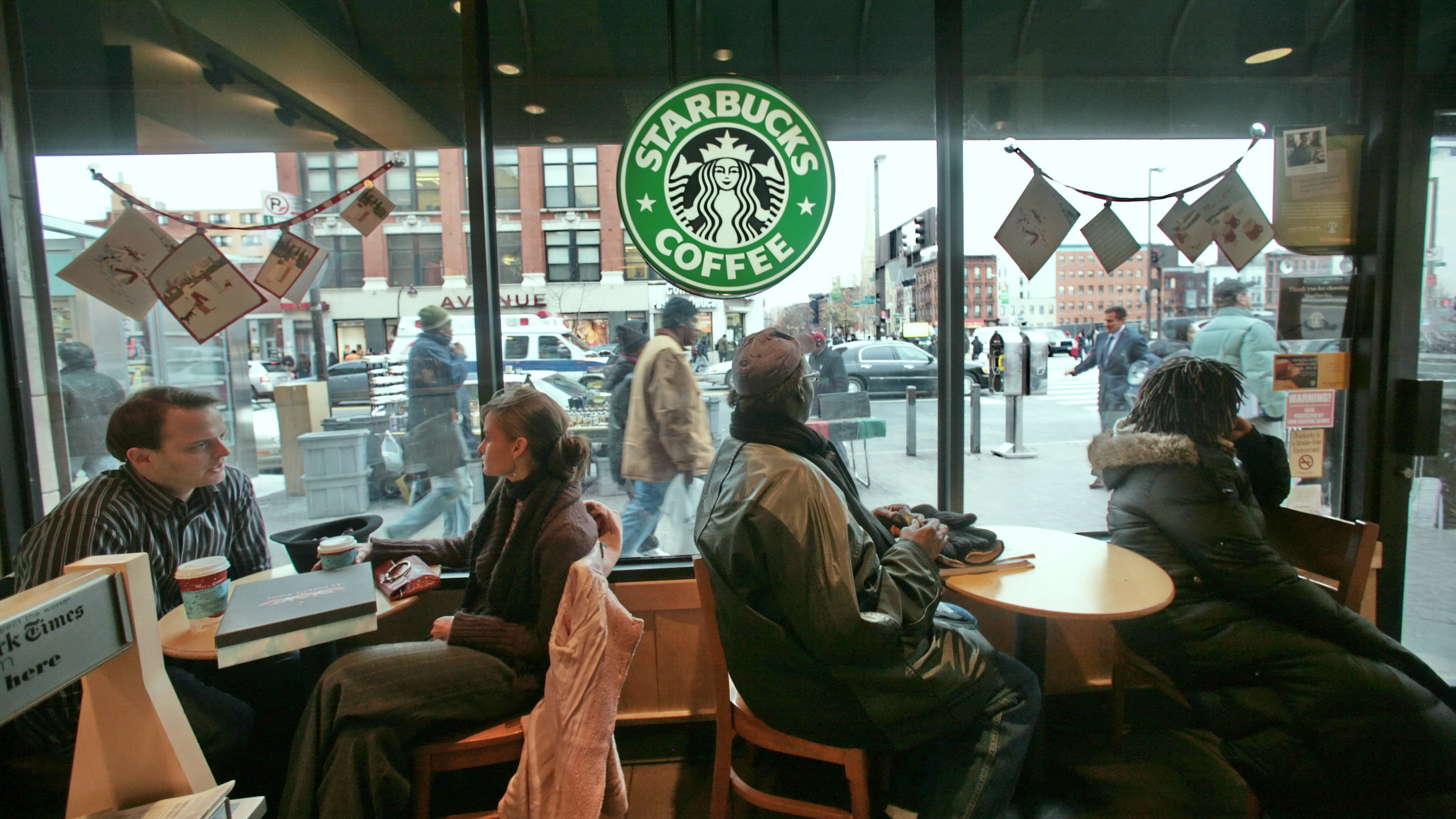 Patrons sit inside a Starbucks in the New York neighborhood of Harlem on Monday Dec. 10, 2007. Increasingly, Harlem's commercial and cultural backbone, 125th Street, has seen many of its black-owned businesses forced out by high rents and replaced by branches of national chain brands like Starbucks. Harlem is the historic capital of black American culture, but like many New York neighborhoods, it is rapidly changing and old-timers worry that redevelopment will wipe out mom-and-pop stores and affordable housing, along with the area's distinct character.