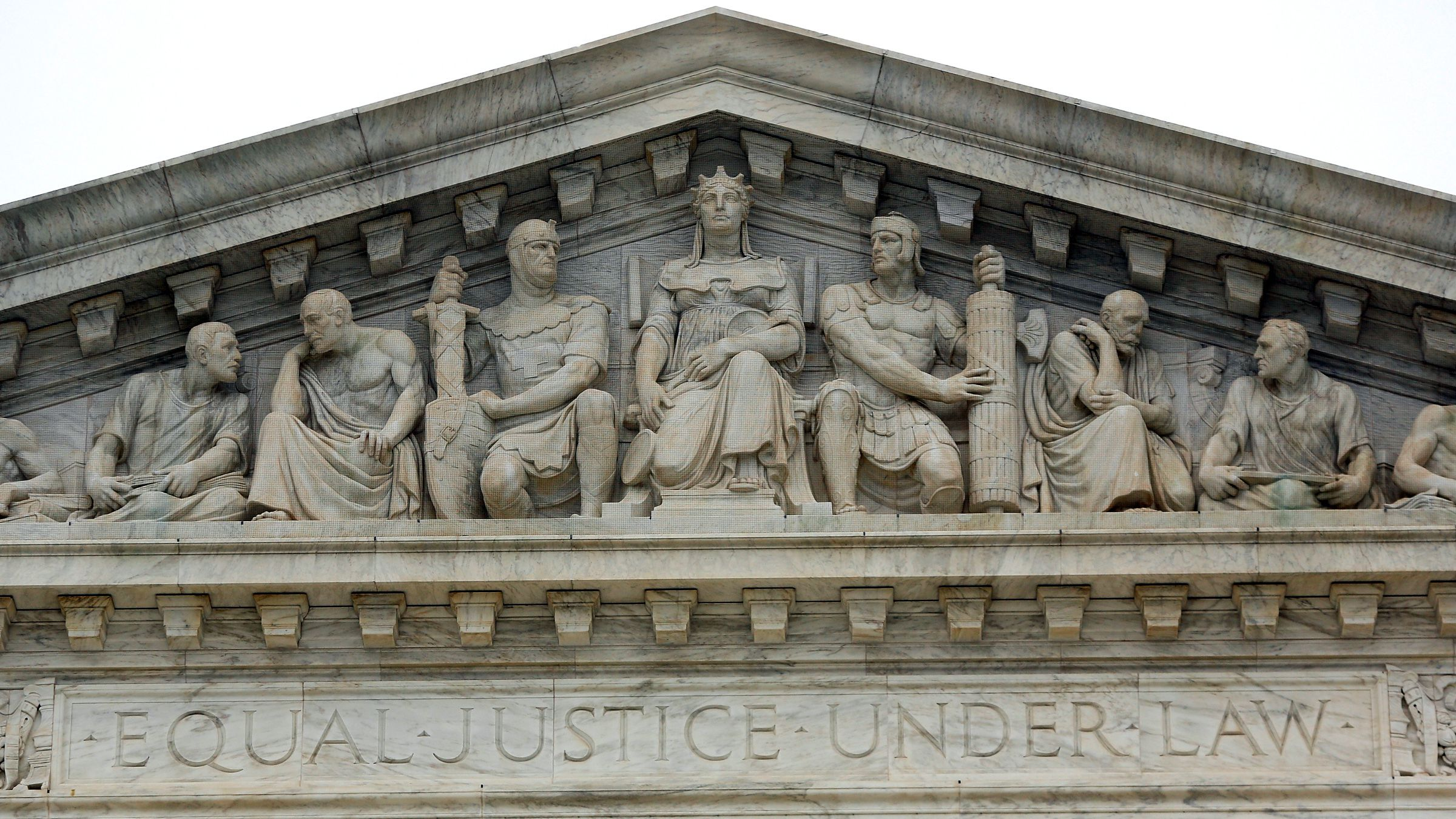 """The phrase """"Equal Justice Under Law"""" adorns the west entrance to the U.S. Supreme Court building in Washington December 3, 2014. Picture taken December 3, 2014. To match Special Report SCOTUS-ELITES/"""