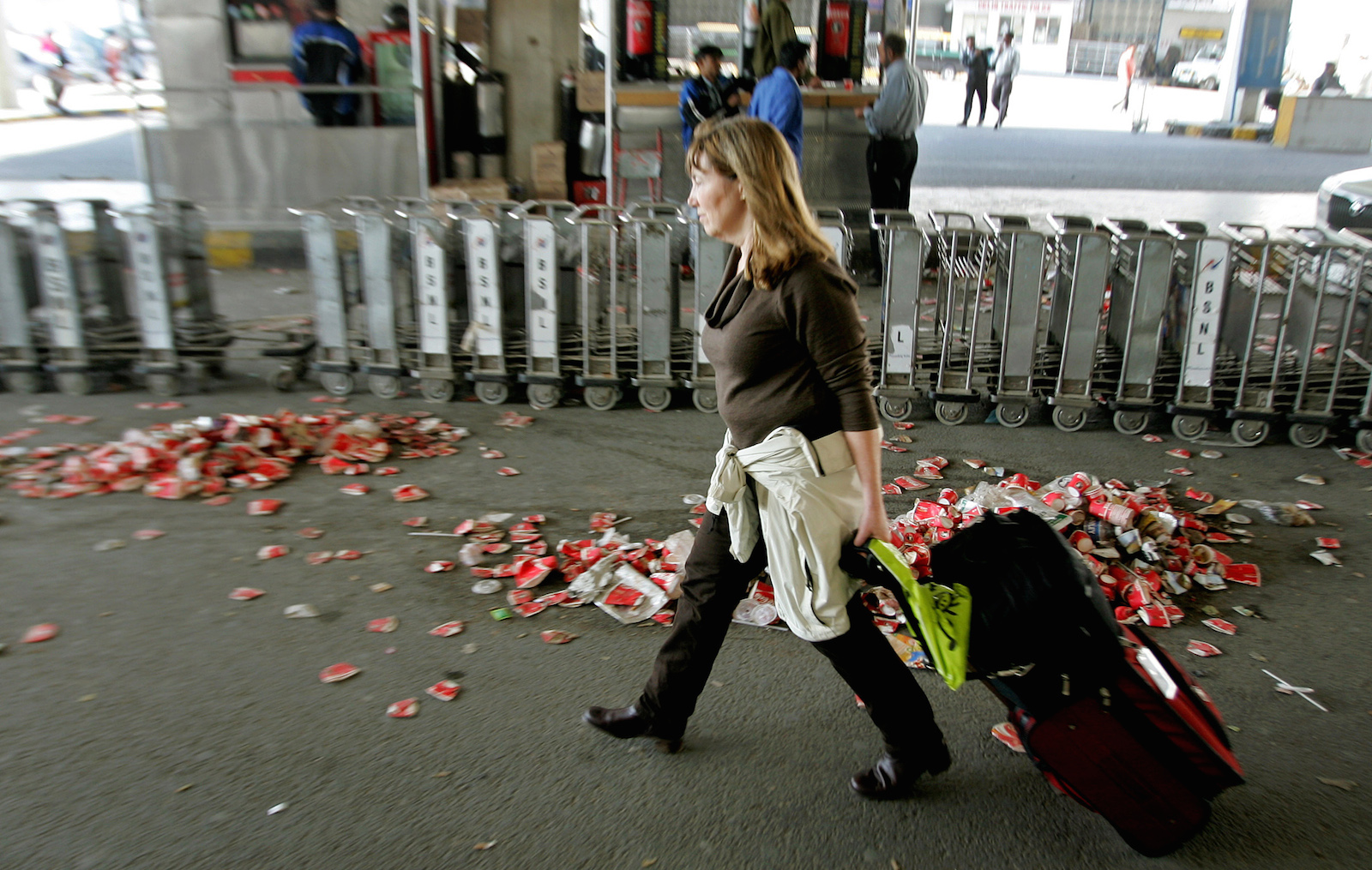 A tourist walks past garbage disposed outside the airport in New Delhi