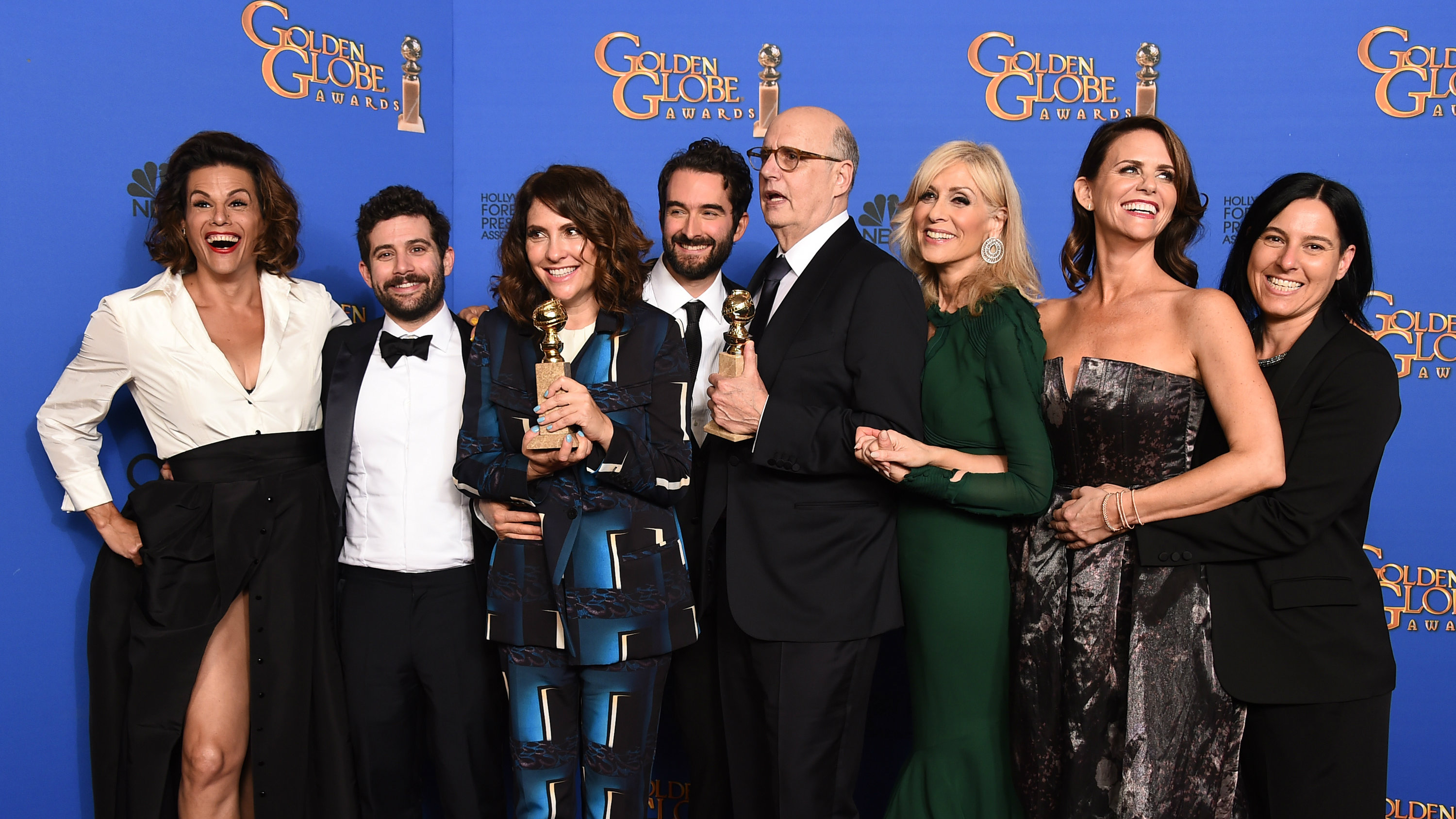 """Program creator Jill Soloway and actor Jeffrey Tambor along with the cast of """"Transparent"""" pose backstage with the award for Best Television Series - Comedy or Musical at the 72nd Golden Globe Awards in Beverly Hills, California January 11, 2015."""