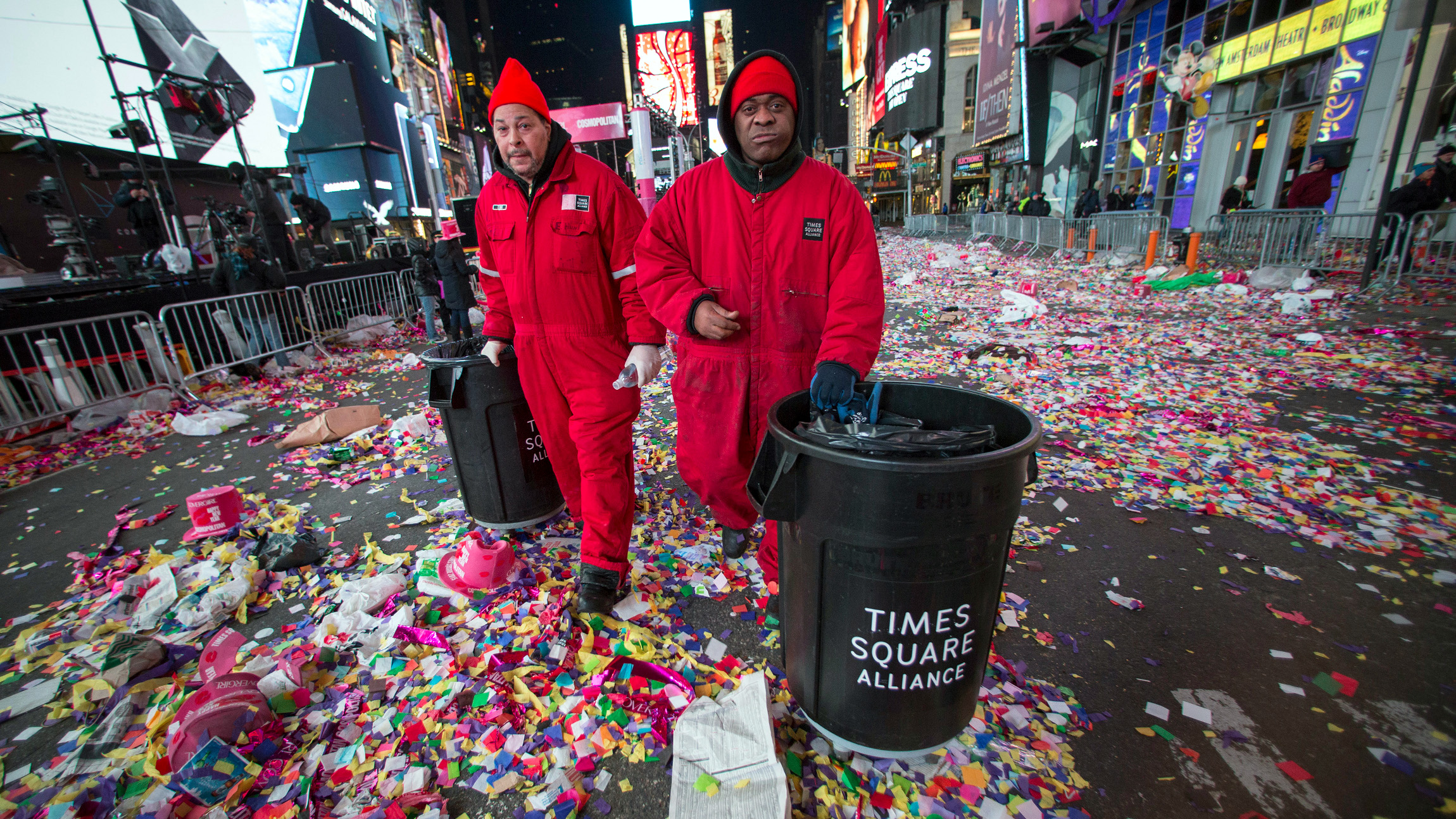 Workers prepare to clear confetti from the streets after New Year's Eve celebrations in Times Square, New York, January 1, 2015.
