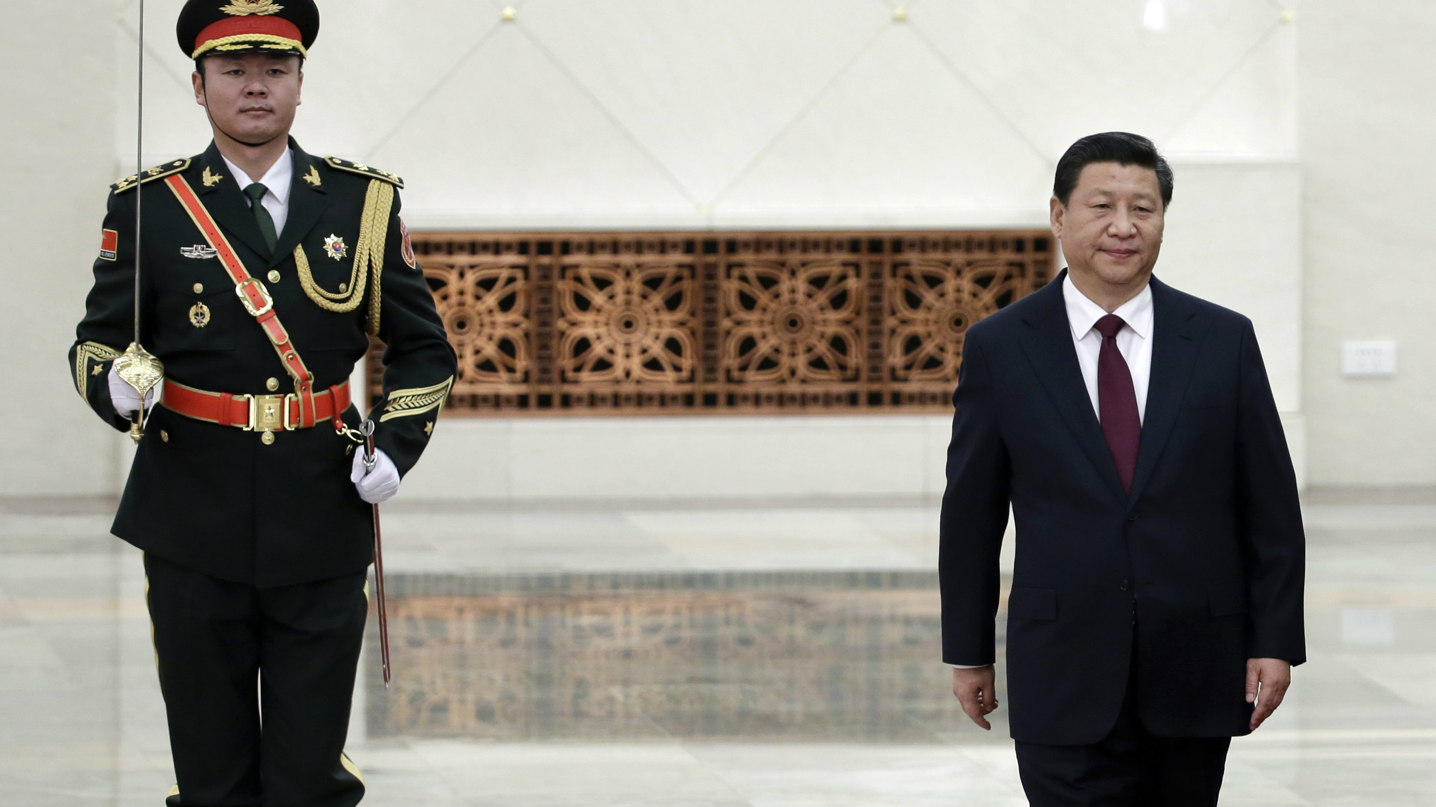 China's President Xi Jinping stands during a welcoming ceremony at the Great Hall of the People in Beijing, December 23, 2014. Picture taken December 23, 2014.