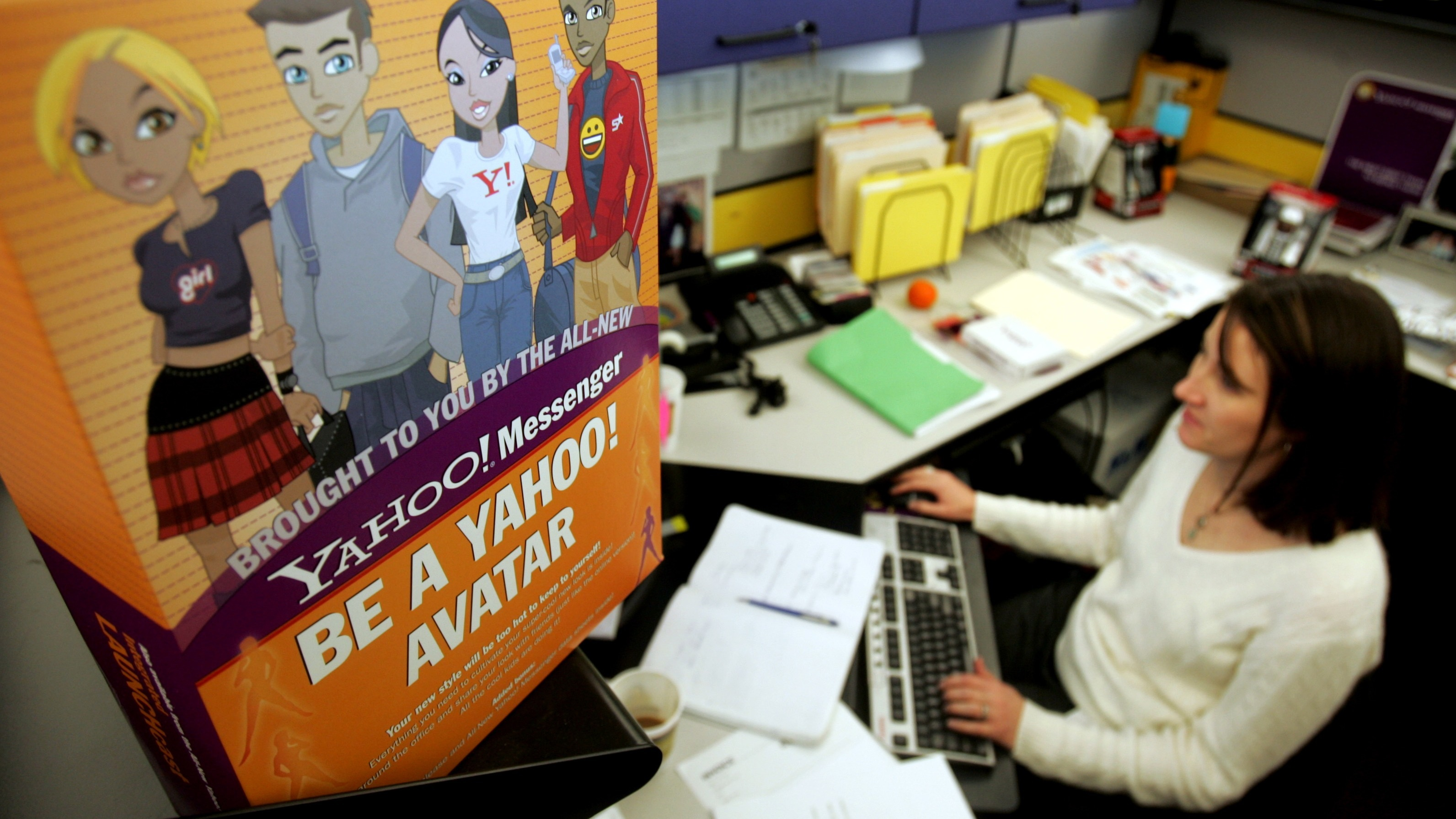 Yahoo! Inc. employee Terrell Karlsten works at her desk as she works on the Yahoo! Messenger service at company headquarters in Sunnyvale, Calif., Tuesday, Jan. 17, 2006. (AP Photo/Paul Sakuma)