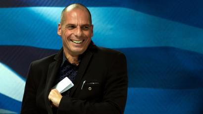"Newly appointed Greek finance minister Yanis Varoufakis smiles after hand over ceremony in Athens, January 28, 2015. Greece's finance minister on Wednesday said he plans to meet European counterparts to find a deal between the country and its creditors to replace the current bailout programme, stressing that one could be found without a ""duel"" with Europe."