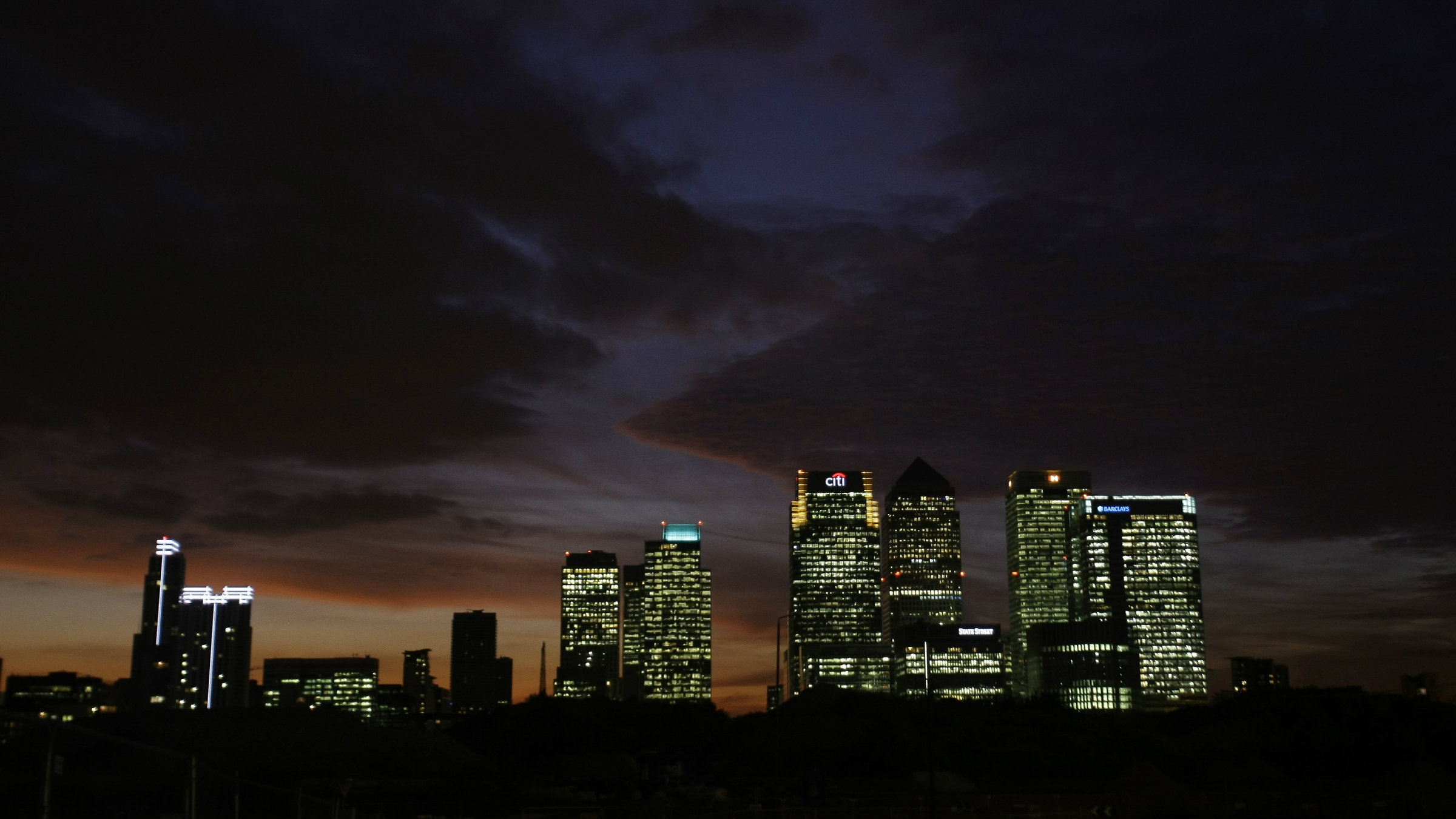 The Canary Wharf district is seen at sunset in London.