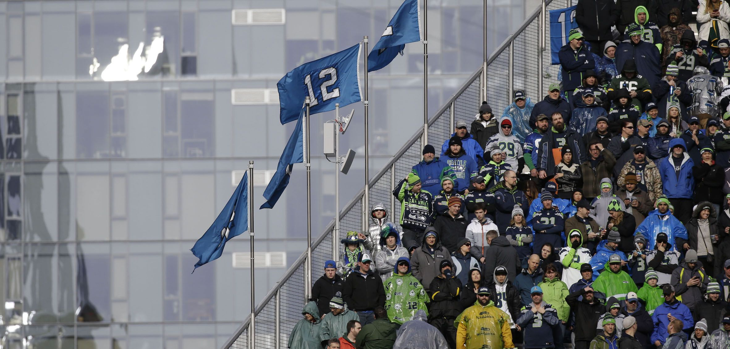 Seattle Seahawks fans watch during the first half of the NFL football NFC Championship game against the Green Bay Packers Sunday, Jan. 18, 2015, in Seattle. (AP Photo/Jeff Chiu)