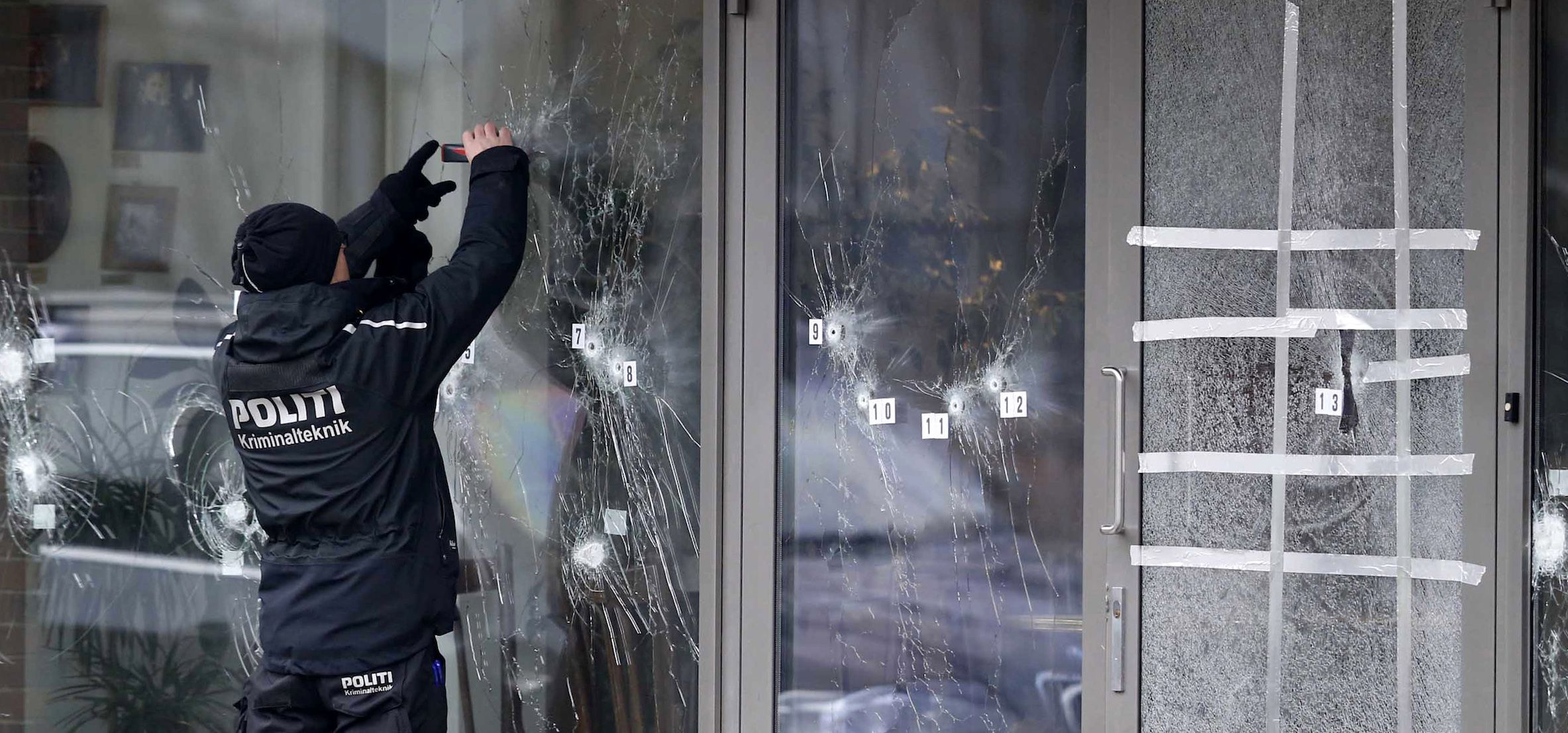A police investigator works at the scene of Saturday's shooting at a free speech event in Copenhagen, Sunday, Feb. 15, 2015. Danish police shot and killed a man early Sunday suspected of carrying out shooting attacks at a free speech event and then at a Copenhagen synagogue, killing two men, including a member of Denmark's Jewish community. Five police officers were also wounded in the attacks. (AP Photo/Polfoto, Jens Dresling) DENMARK OUT