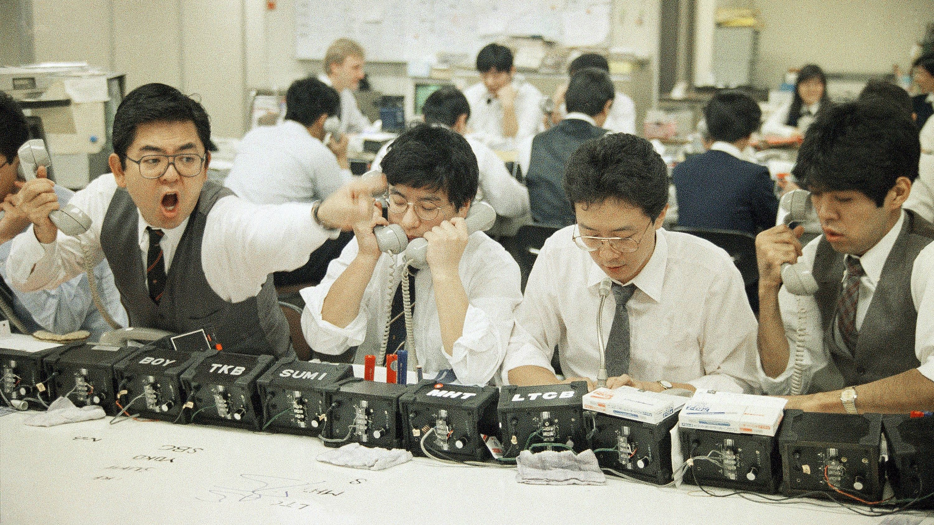 A Tokyo money dealer shouts and gestures during heavy trading at the Tokyo Foreign Exchange market in Tokyo, Nov. 1987. The U.S. dollar traded low as worldwide major stock market experienced crashes this year. (AP Photo/Sadayuki Mikami)