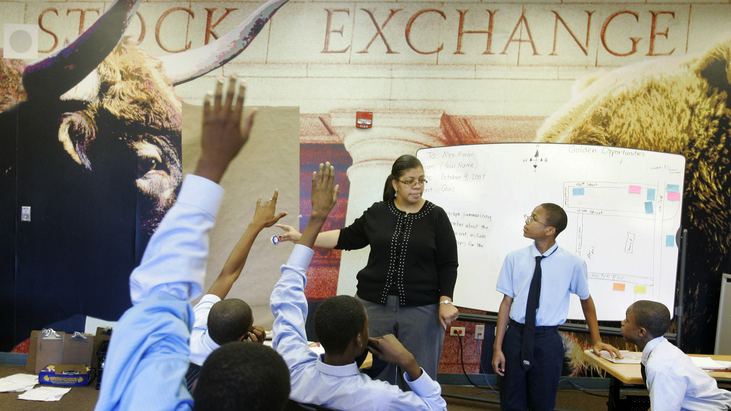 Connie Moran teaches class at the Ariel Community Academy in Chicago, Tuesday, Oct. 9, 2007. The school, sponsored by an African-American mutual fund company, gives kids real money to invest as a class that they collect when they graduate. (AP Photo/Charles Rex Arbogast)
