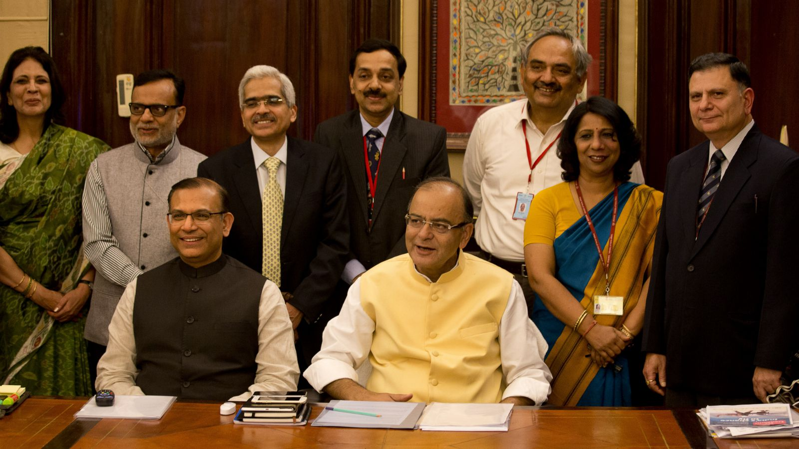 Indian finance minister Arun Jaitley, centre, and Indian minister of state for finance Jayant Sinha, seated left, pose for photographs with their team on the eve of annual budget presentation, in New Delhi, India, Friday, Feb. 27, 2015. The Economic Survey, an annual report on the state of Asia's third-largest economy, said Friday that India's economy will grow more than 8 percent in the upcoming financial year, which would make it the world's fastest growing economy, surpassing China.