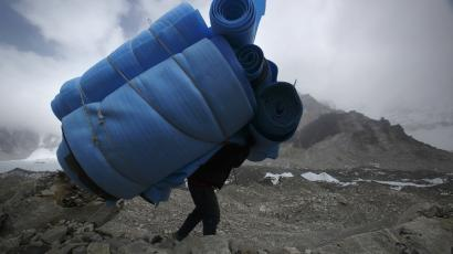 climber with giant pack