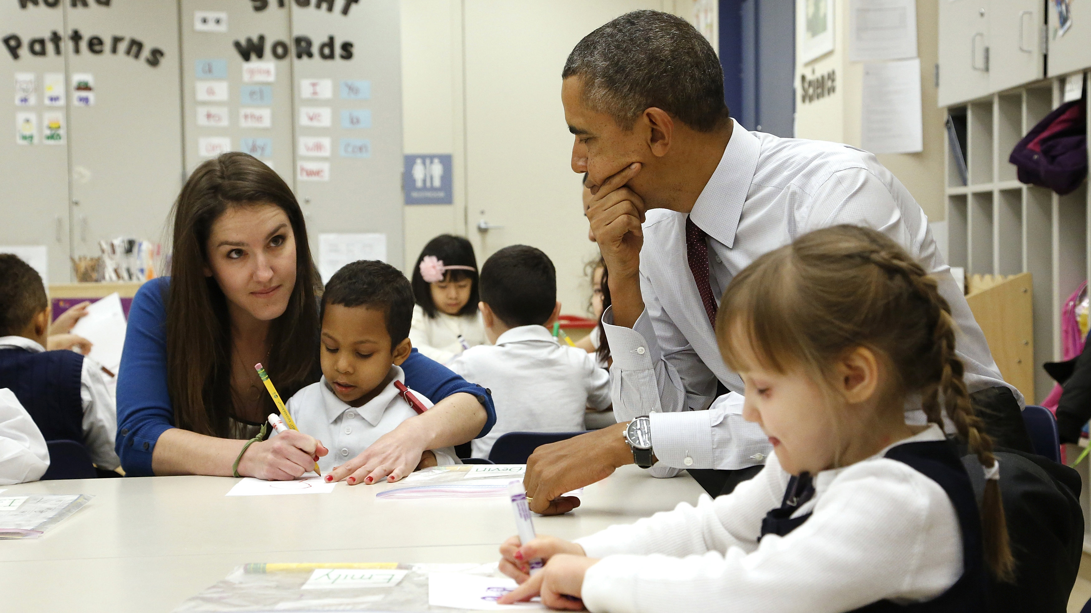 elementary school students with teacher and obama