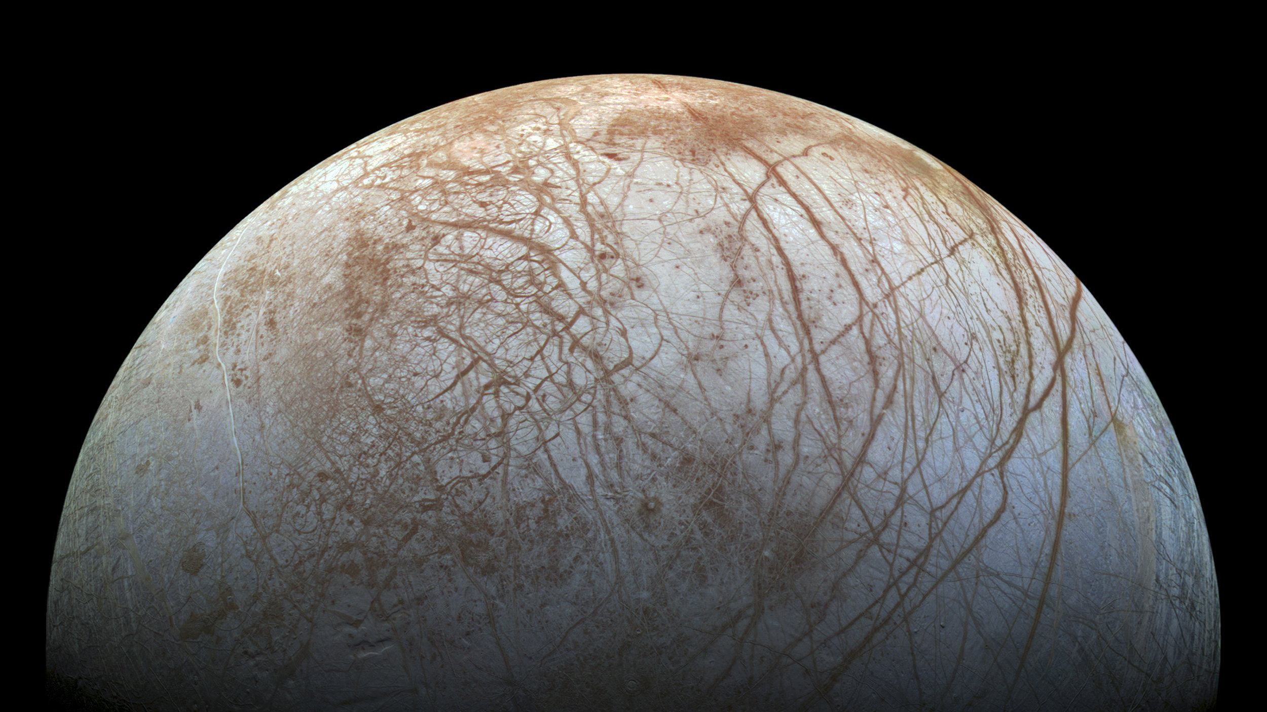 A new mosaic made from images taken by NASA's Galileo spacecraft in the late 1990's is shown of the surface of Jupiter's icy moon, Europa, as it looms large in this newly-reprocessed, higher resolution color view in this handout provided by NASA November 24, 2014. This newer version was created from images assembled into a realistic color view of the surface that approximates how Europa would appear to the human eye. NASA/JPL-Caltech/SETI Institue/Handout via Reuters