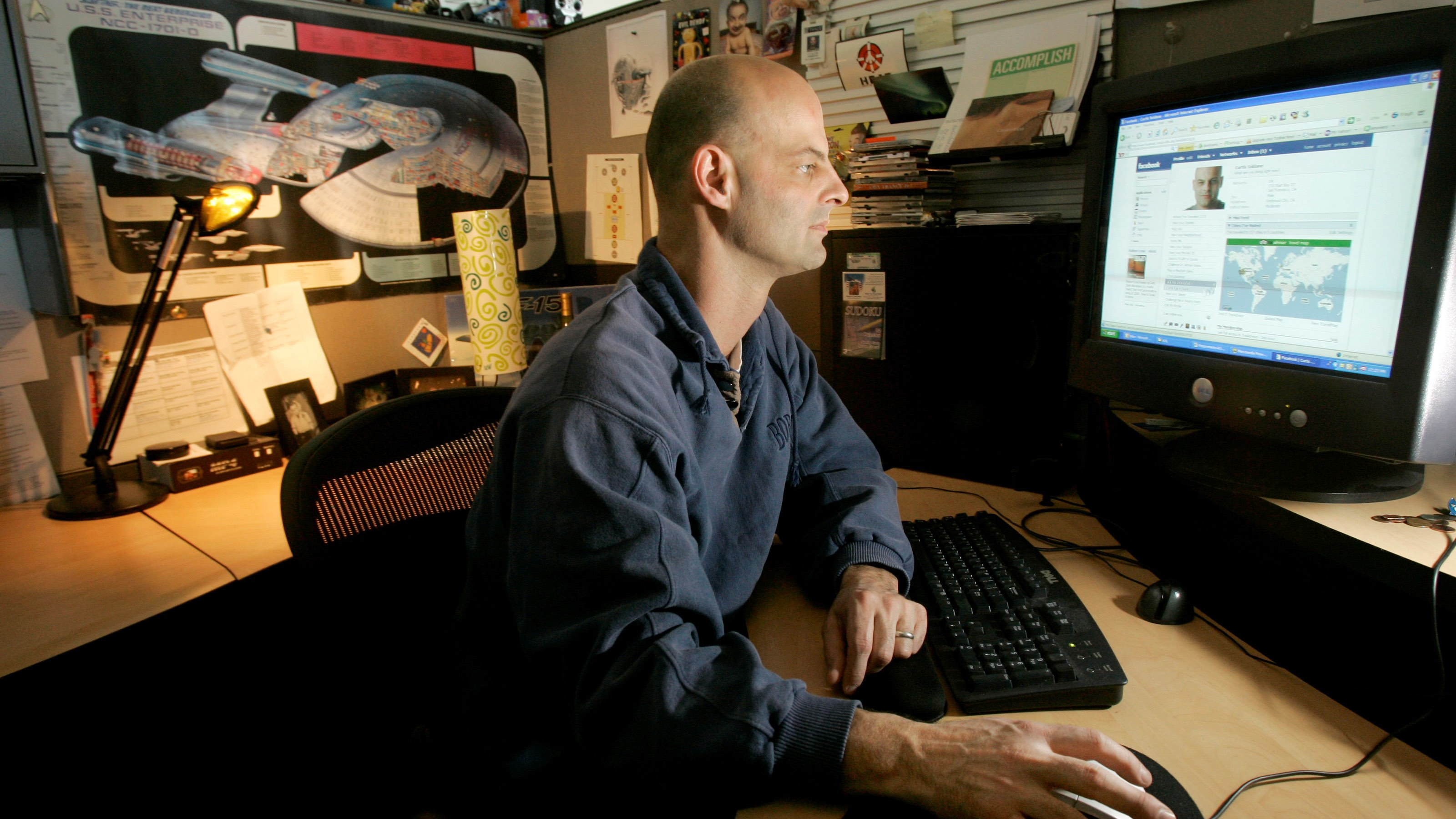 Curtis Soldano, associate producer at Electronic Arts, looks at his Facebook page at his cubicle in Redwood City, Calif., Thursday, Jan. 17, 2008. (AP Photo/Jeff Chiu)