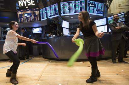 Children play during the trading day on the floor of the New York Stock Exchange.