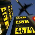 Gasoline prices are advertised at a gas station near Lindbergh Field as a plane approaches to land in San Diego, California June 1, 2008.