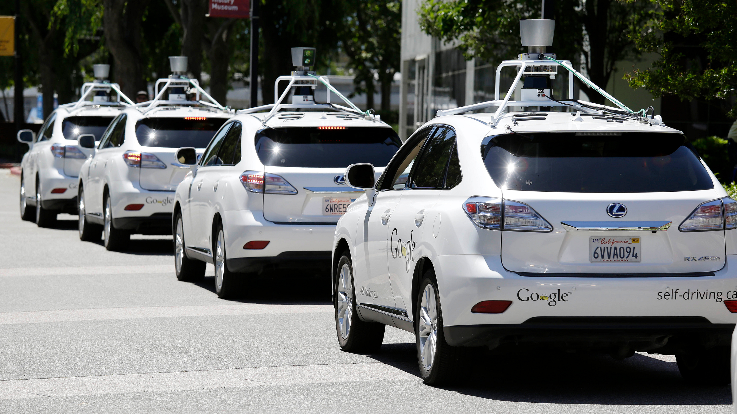 "FILE - This file photo taken Tuesday, May 13, 2014 shows a row of Google self-driving cars outside the Computer History Museum in Mountain View, Calif. California's Department of Motor Vehicles will miss a year-end deadline to adopt new rules for cars of the future because regulators first have to figure out how they'll know whether ""driverless"" vehicles are safe."
