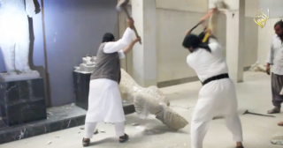 IS fighters unveiling old statues in the Ninawa museum dating back to the Assyrian empire and then dragging them down to the ground, where they fall into pieces.