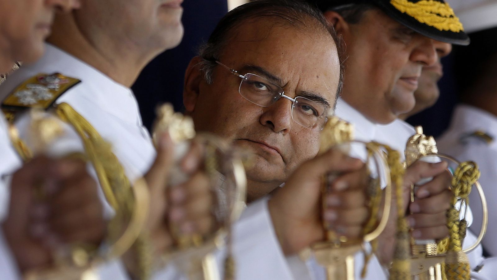 "Indian Defense Minister Arun Jaitley attends the commissioning ceremony of Indian Coast Guard ships ""Achook"" and ""Agrim"" at a naval dockyard in Mumbai, India, Saturday, June 7, 2014."