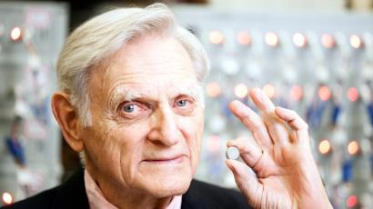 In this undated photo provided by the University of Texas at Austin, John Goodenough, godfather of the lithium ion battery, poses for photos with one of his devices. Goodenough, 90, is the man responsible for the 1979 breakthrough that led to the first commercial lithium ion battery in 1991. He will receive the National Medal of Science at the White House next month.