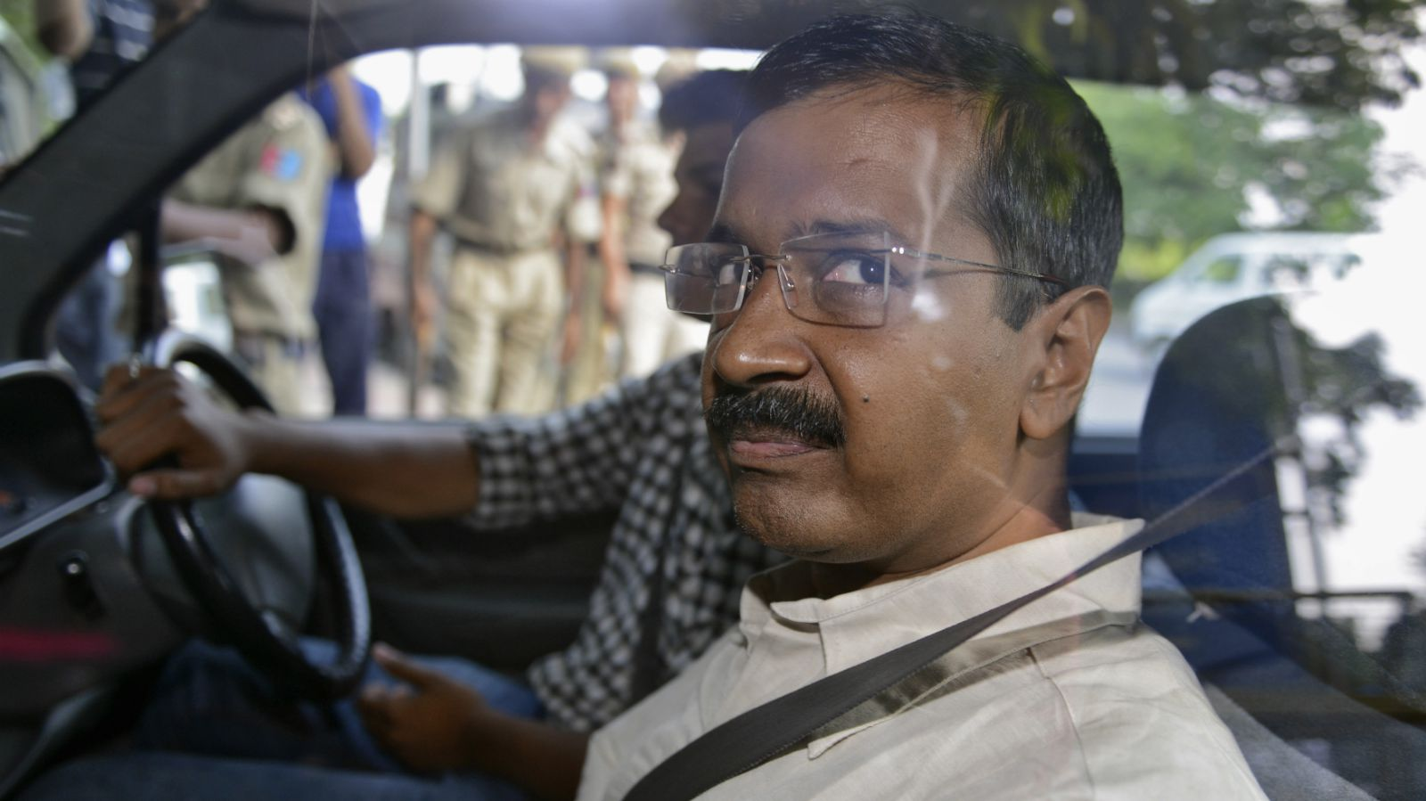 Arvind Kejriwal, the head of the Aam Aadmi (Common Man) Party (AAP), which briefly controlled the state government in Delhi, looks out from inside his car as he arrives at a court in New Delhi May 21, 2014. Kejriwal was sent to judicial custody for two days by a New Delhi court on Wednesday in connection with a defamation case filed against him by a leader of Hindu nationalist Bharatiya Janata Party (BJP).