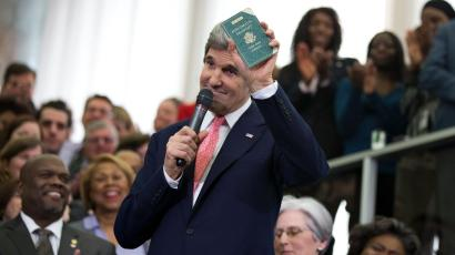 New Secretary of State John Kerry shows his first diplomatic passport he got when he was eleven years old when his father was in the foreign service, Monday, Feb. 4, 2013, during a ceremony welcoming him as the 68th secretary of state, at the State Department in Washington.