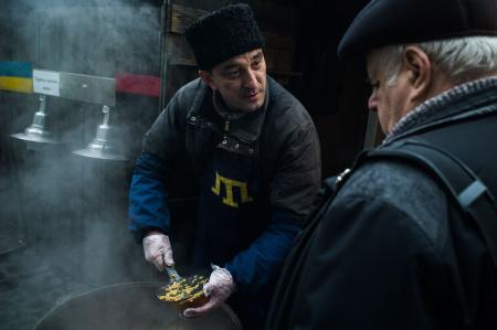 Yashar, a high-school French teacher from Crimea who now sells home-made food in the Lviv market.