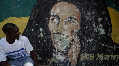 man next to marley mural