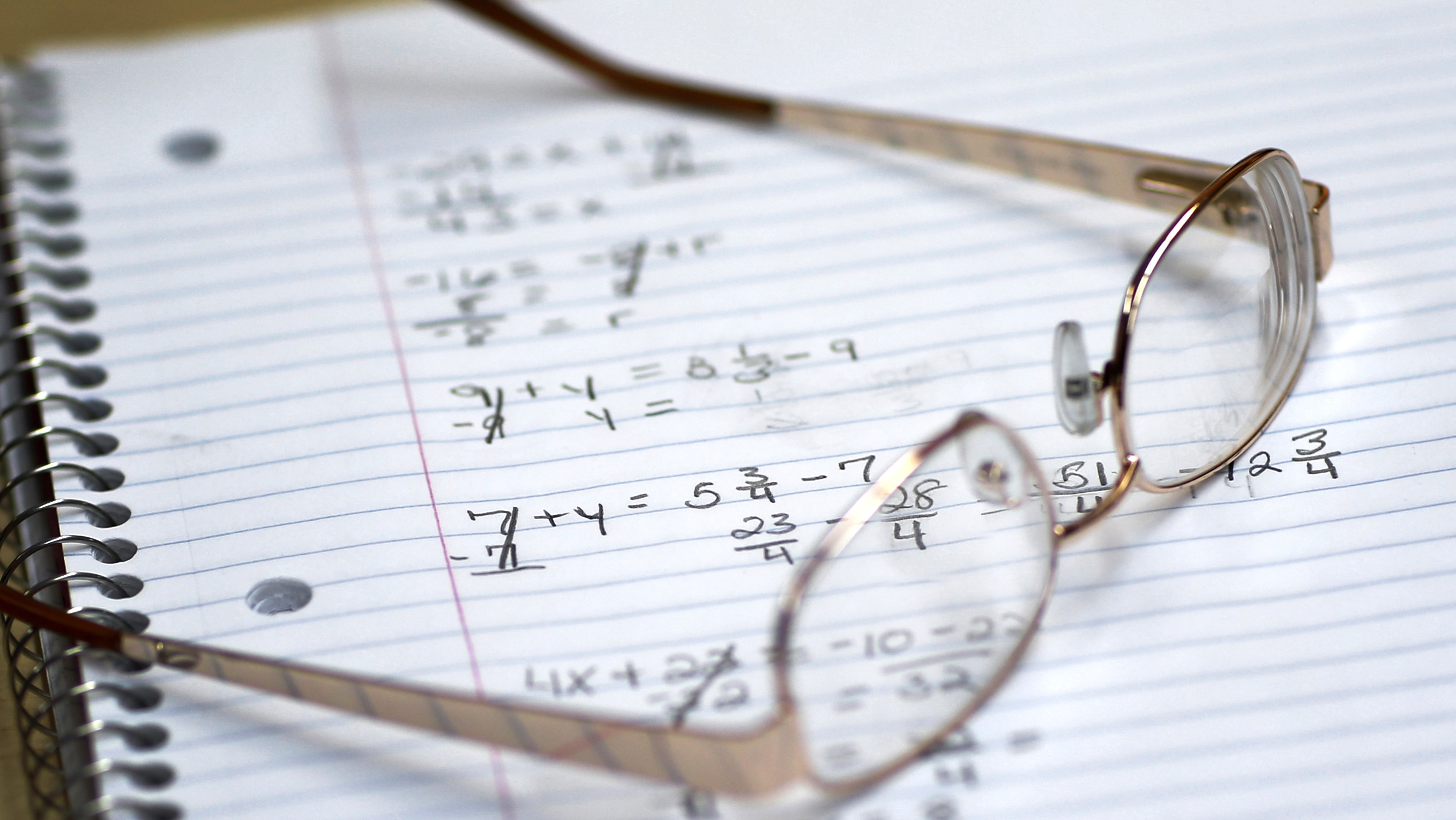 "This photo taken March 12, 2014, shows a student's glasses sitting on a notebook containing math exercises in a remedial mathematics course at Baltimore City Community College in Baltimore. Only about a quarter of students nationally who take developmental _ or remedial _ classes ever graduate. The problem is so profound that the advocacy group Complete College America dubs remedial classes the ""bridge to nowhere."" The challenge, educators say, is that even as billions is spent annually on remedial classes, many of these students run out of financial aid before they can complete their credit requirements, get discouraged by non-credit classes or find themselves unable to complete them. The Baltimore school is one of several places around the country looking to improve the odds for these students. (AP Photo/Patrick Semansky)"