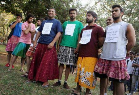 Male protestors wearing skirts in Bangalore, India.
