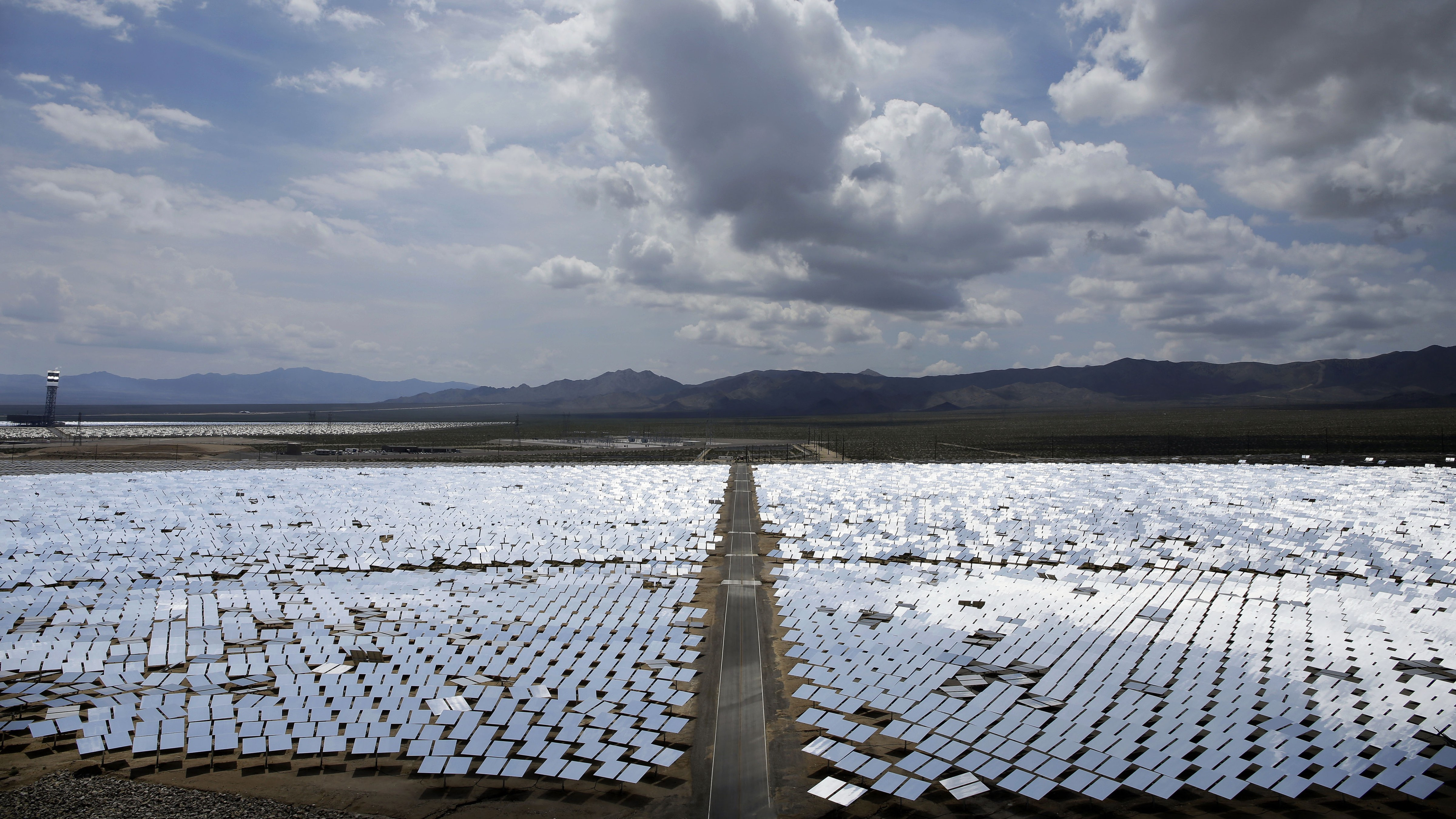 This Aug. 13, 2014 photo shows an array of mirrors at the Ivanpah Solar Electric Generating site in Primm, Nev. The largest solar power plant of its type in the world, promoted as a turning point in green energy, isn't producing the expected energy and one of the reasons is as basic as it gets: The sun isn't shining as often as expected. (AP Photo/John Locher, File)