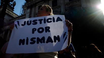 """A woman holds a sign that reads, """"Justice for Nisman"""" during a demonstration outside Argentina's Congress in Buenos Aires February 4, 2015. Various rights groups marched through Buenos Aires to demand full disclosure of the AMIA Jewish community center case and justice over the mysterious death of prosecutor Alberto Nisman, who was investigating the 1994 bombing of the AMIA."""