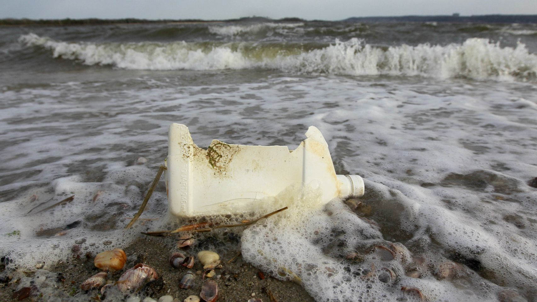 In this April 18, 2011 photo, a plastic container litters the beach in Sandy Hook, N.J. Clean Ocean Action, the environmental group that has been doing beach sweeps for 25 years, says in a report to be released Tuesday, April 19, 2011 that an all-time high of 475,321 pieces of litter were removed from the state's 127-mile shoreline last year. The 8,372 people who participated in spring and fall cleanups also set a record. (AP Photo/Julio Cortez