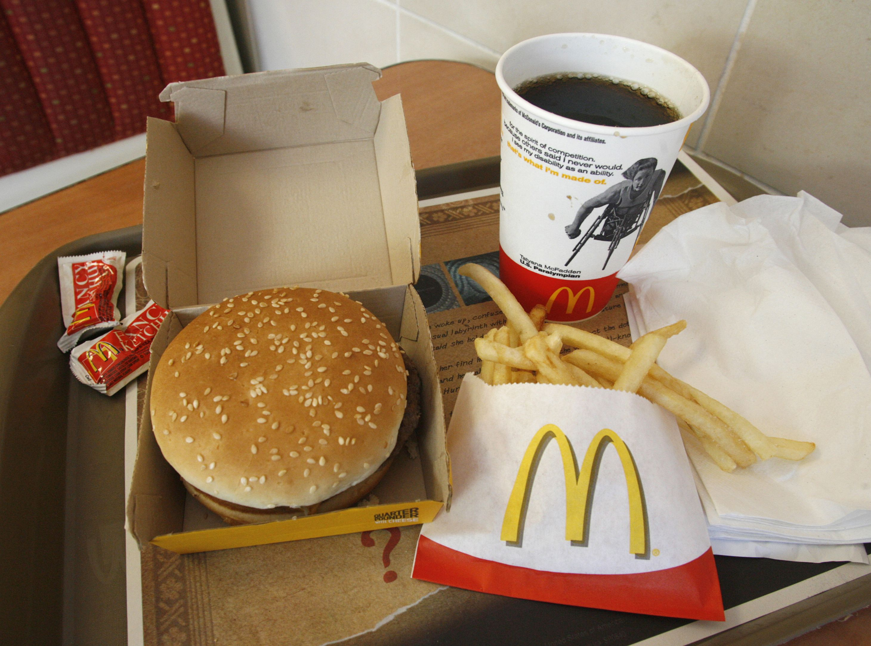 A meal consisting of a Quarter Pounder hamburger, french fries and soft-drink is pictured at a McDonald's restaurant in Los Angeles, California July 23, 2008. McDonald's on Wednesday posted a quarterly profit that topped expectations, boosted by continued strength overseas, the sale of its stake in sandwich chain Pret A Manger, and the weak dollar. But the world's biggest restaurant chain reported segment margins that were softer than some analysts expected and forecast rising beef costs, and its shares were off 19 cents.    REUTERS/Fred Prouser             (UNITED STATES) - RTR20GU7