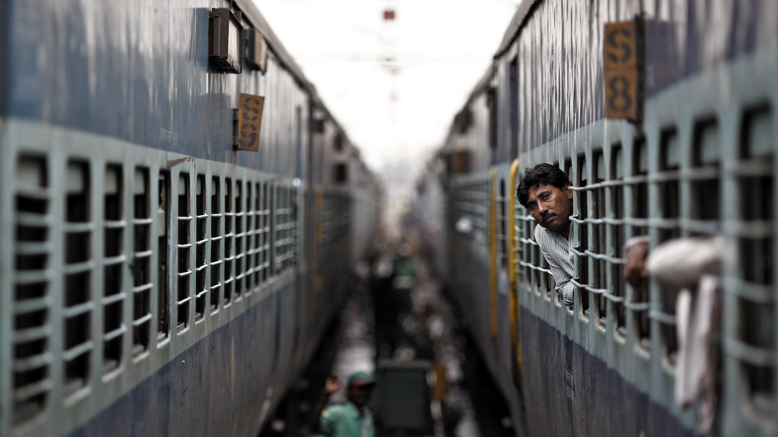 A passenger looks through the window of a train as he waits for electricity to be restored at a railway station in New Delhi July 31, 2012. Grid failure hit India for a second day on Tuesday, cutting power to hundreds of millions of people in the populous northern and eastern states including the capital Delhi and major cities such as Kolkata. REUTERS/Adnan Abidi