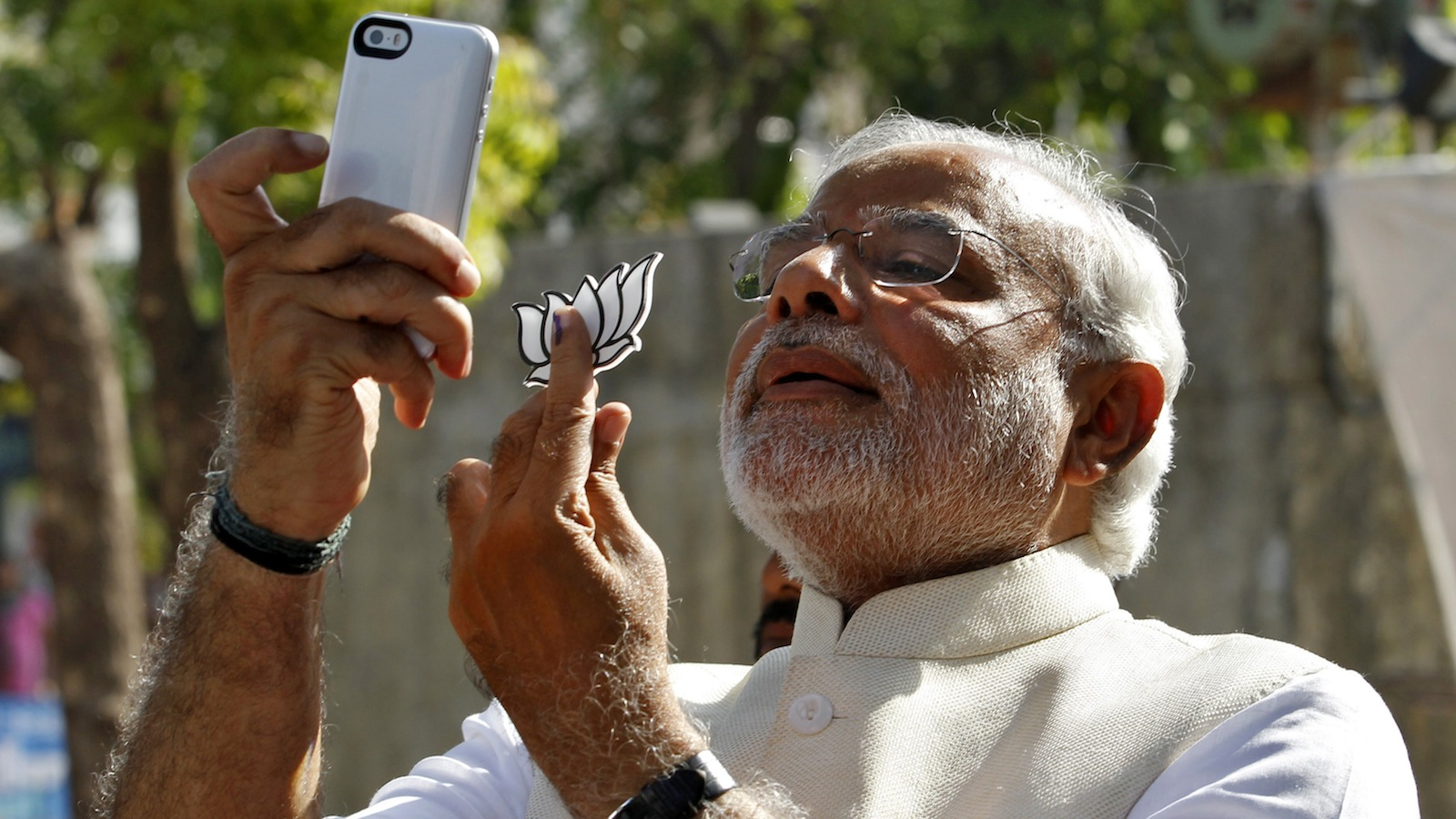"Hindu nationalist Narendra Modi, the prime ministerial candidate for India's main opposition Bharatiya Janata Party (BJP), takes a ""selfie"" with a mobile phone after casting his vote at a polling station during the seventh phase of India's general election in the western Indian city of Ahmedabad April 30, 2014. Around 815 million people have registered to vote in the world's biggest election - a number exceeding the population of Europe and a world record - and results of the mammoth exercise, which concludes on May 12, are due on May 16. REUTERS/Amit Dave"