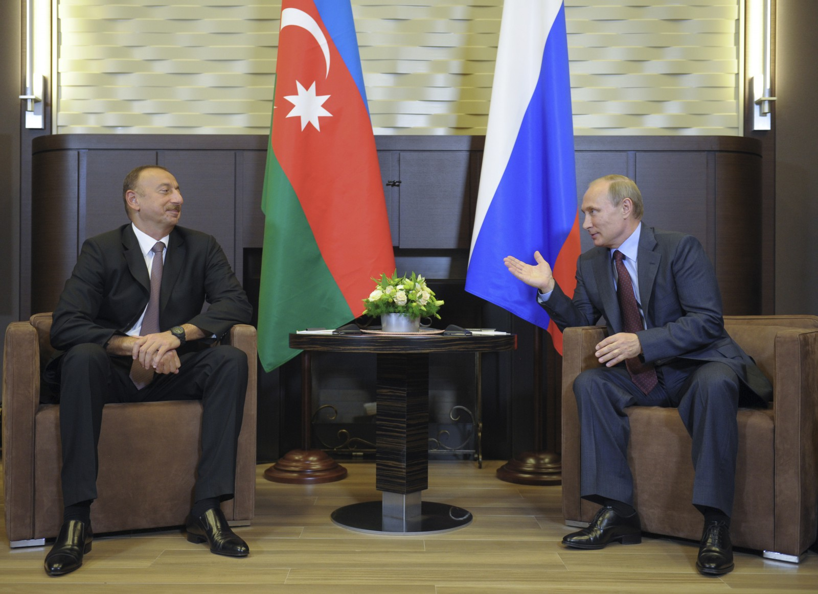 Russia's President Vladimir Putin (R) talks to Azerbaijan's President Ilham Aliyev during their meeting in Sochi, August 9, 2014. Azerbaijan and Armenia accused each other on Monday of stoking tensions over the breakaway enclave of Nagorno-Karabakh inside Azerbaijan after a recurrence of fighting last week, although Yerevan said there was no immediate threat of war. The presidents of Armenia and Azerbaijan, both former Soviet republics, are expected to meet in the Russian Caucasus city of Sochi to discuss ways to resolve the conflict. REUTERS/Alexei Druzhinin/RIA Novosti/Kremlin (RUSSIA - Tags: POLITICS) ATTENTION EDITORS - THIS IMAGE HAS BEEN SUPPLIED BY A THIRD PARTY. IT IS DISTRIBUTED, EXACTLY AS RECEIVED BY REUTERS, AS A SERVICE TO CLIENTS - RTR41SKU