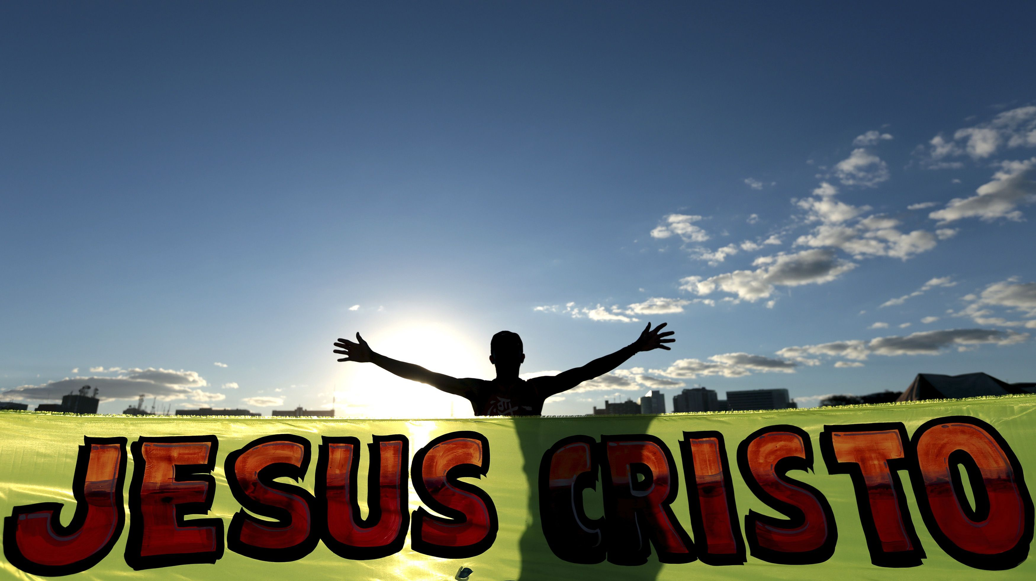"""An evangelical Christian is pictured as they march during the """"Jesus Parade"""" in downtown Brasilia August 14, 2014. Brazil's increasingly powerful evangelical Christians are tantalizingly close to electing one of their own as president next month in what would be a historic shift for the world's largest Catholic nation. Marina Silva, an environmentalist running neck and neck in polls with incumbent President Dilma Rousseff, is a Pentecostal Christian who often invokes God on the campaign trail and has said she sometimes consults the Bible for inspiration when making important political decisions. The parade unites Christians and Evangelical churches in a public expression of faith, praising and worshipping Jesus Christ. The banner reads """"Jesus Christ"""". Picture taken August 14, 2014. To match Insight BRAZIL-ELECTION/EVANGELICALS REUTERS/Joedson Alves (BRAZIL - Tags: POLITICS ELECTIONS RELIGION TPX IMAGES OF THE DAY) - RTR481PR"""
