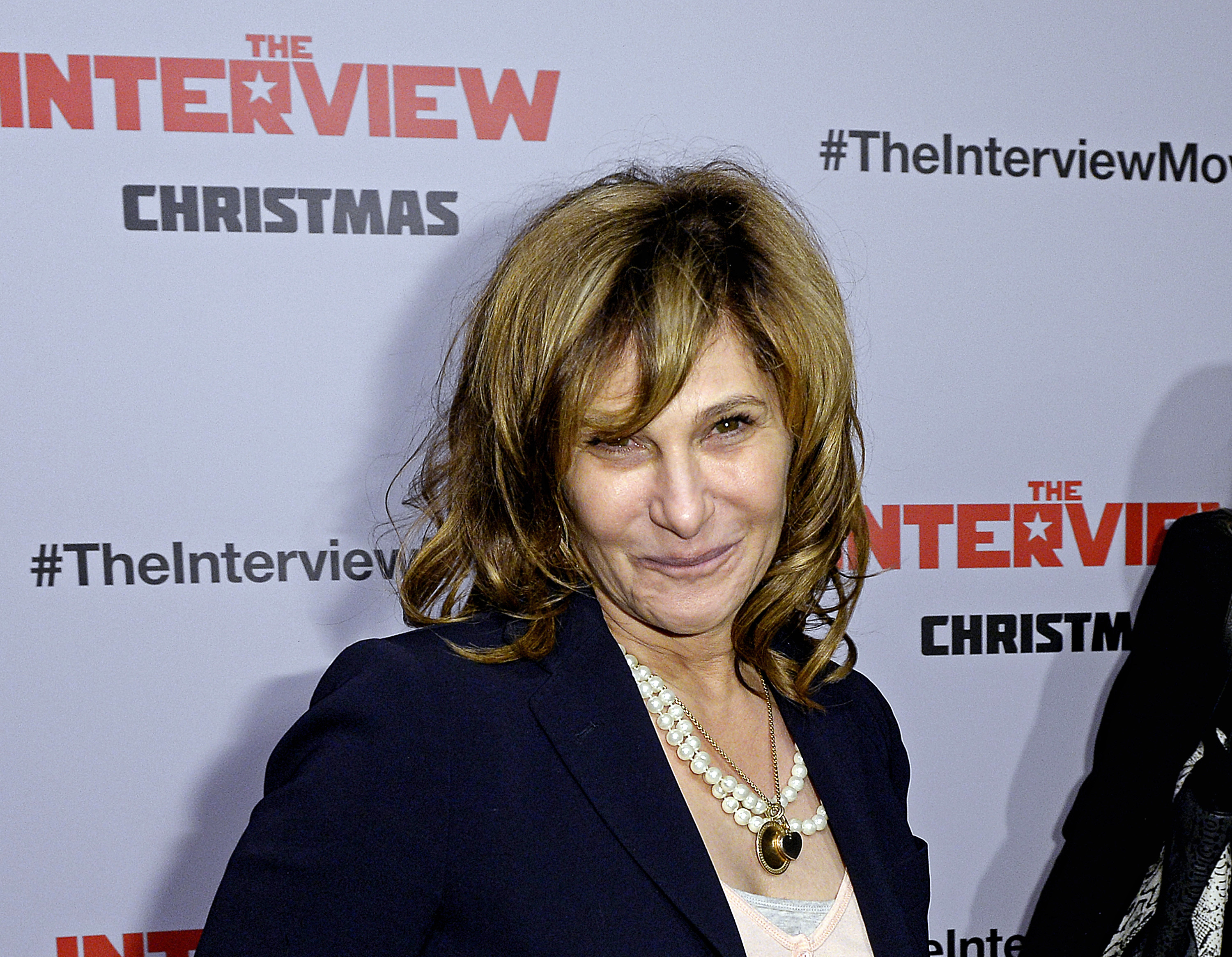 "Sony Pictures Entertainment Co-Chairman Amy Pascal poses during the premiere of ""The Interview"" in Los Angeles, California December 11, 2014.  REUTERS/Kevork Djansezian  (UNITED STATES - Tags: ENTERTAINMENT) - RTR4HPGW"
