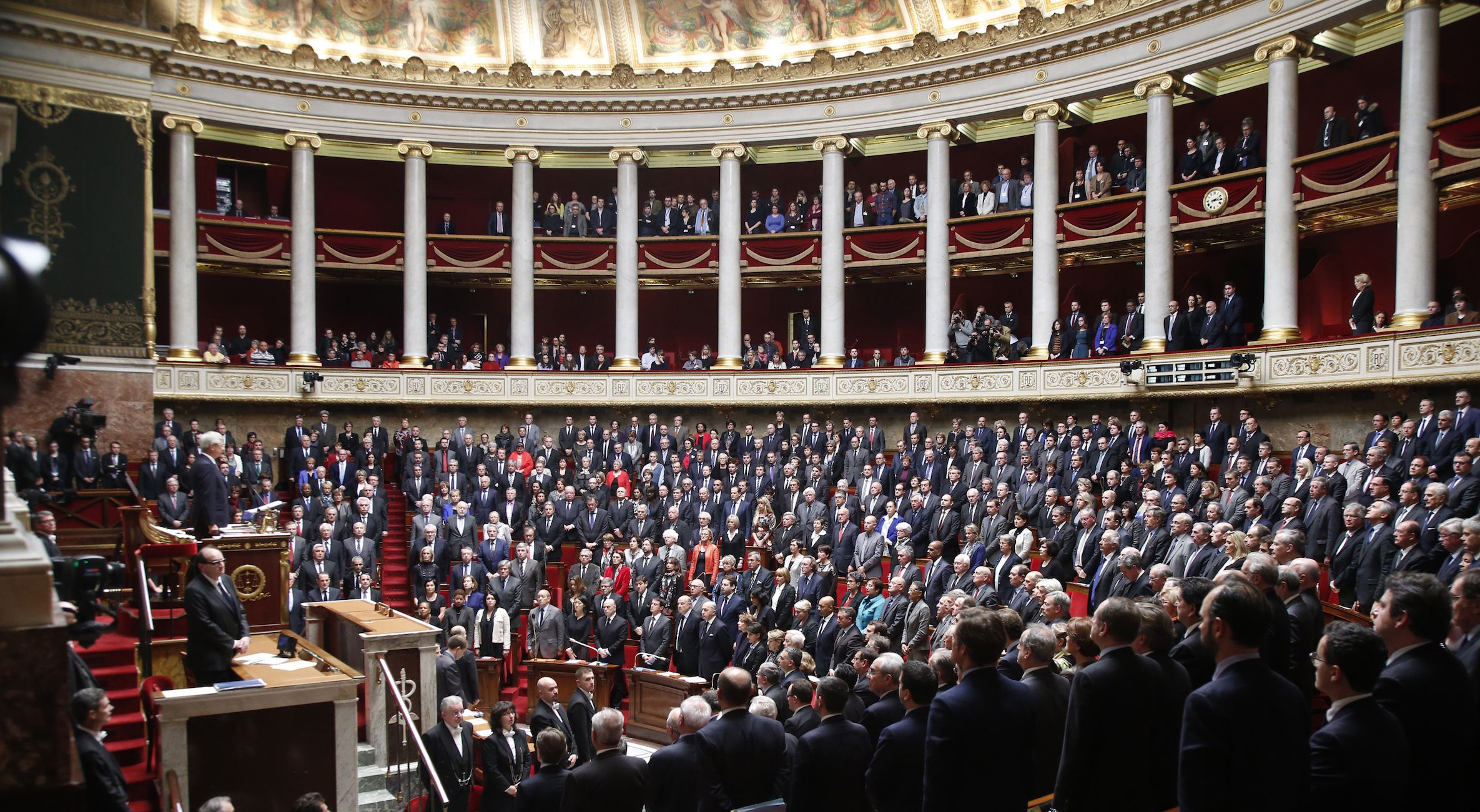 Members of the French government and deputies observe a minute of silence during a session at the National Assembly in Paris January 13, 2015 to pay their respects to the victims of last week's Islamist militant attacks. A total of seventeen people were killed in attacks at the satirical weekly Charlie Hebdo, a shooting in Montrouge, and a hostage taking at a kosher supermarket, Hyper Cacher, at the Porte de Vincennes.  REUTERS/Charles Platiau (FRANCE - Tags: POLITICS CRIME LAW) - RTR4LAC0