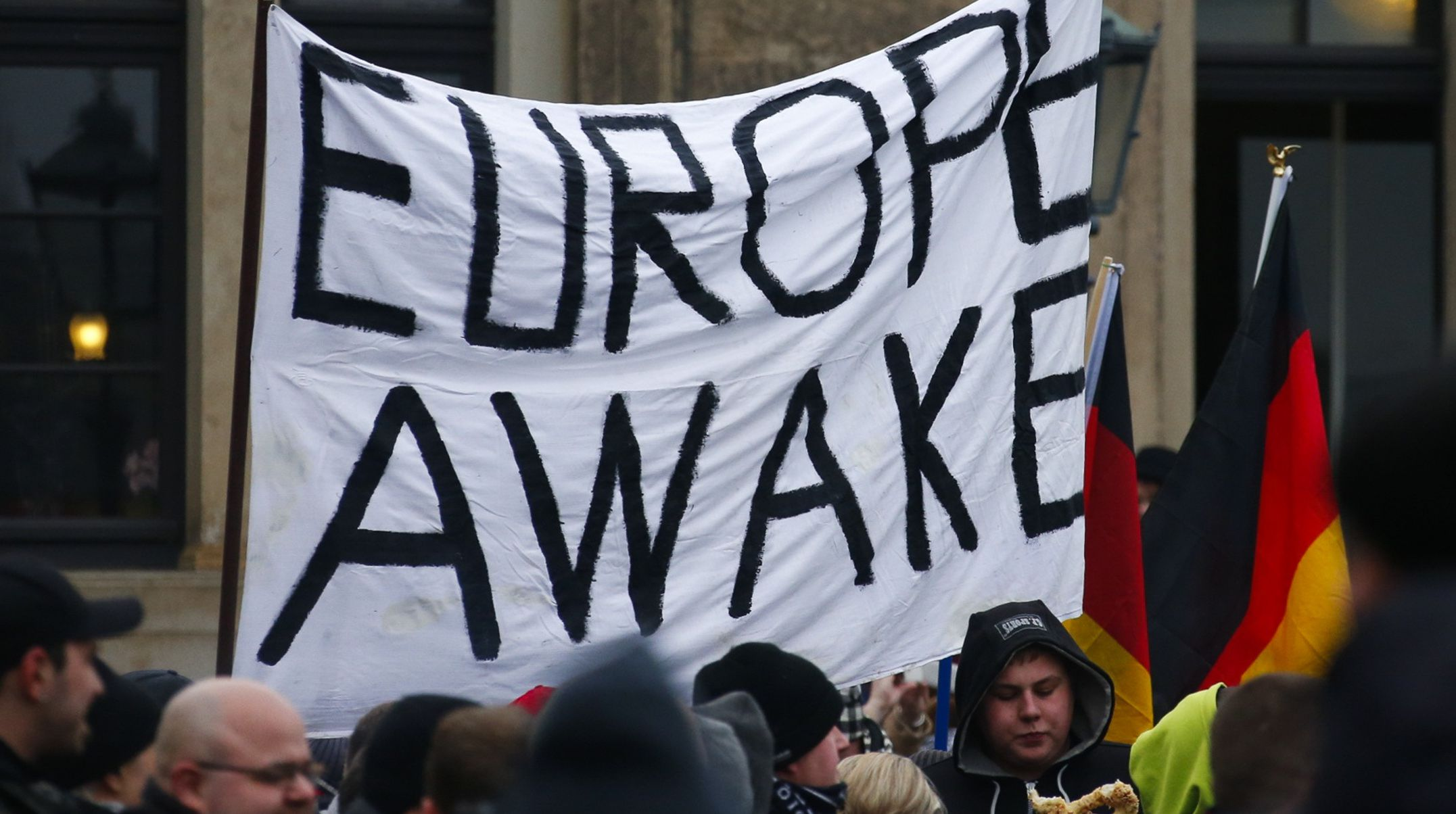 Members of the movement of Patriotic Europeans Against the Islamisation of the West (PEGIDA) hold flags and banners during a PEGIDA demonstration march in Dresden, January 25, 2015. REUTERS/Hannibal Hanschke (GERMANY  - Tags: POLITICS CIVIL UNREST)   - RTR4MTAL