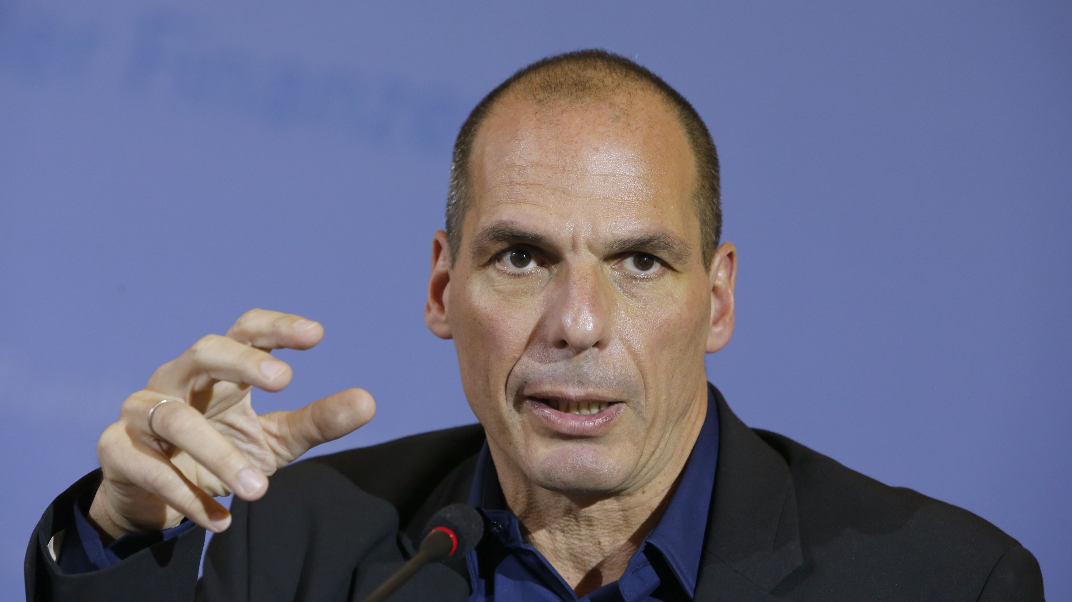 """Greek Finance Minister Yanis Varoufakis addresses a news conference following talks with German Finance Minister Wolfgang Schaeuble, at the finance ministry in Berlin February 5, 2015. The Greek and German finance ministers could """"not even agree to disagree"""" at their meeting on Thursday about the new government in Athens' plans to renegotiate Greece's debt and halt austerity measures prescribed by Berlin, the Greek minister said.       REUTERS/Fabrizio Bensch (GERMANY  - Tags: BUSINESS POLITICS HEADSHOT)   - RTR4OC9O"""