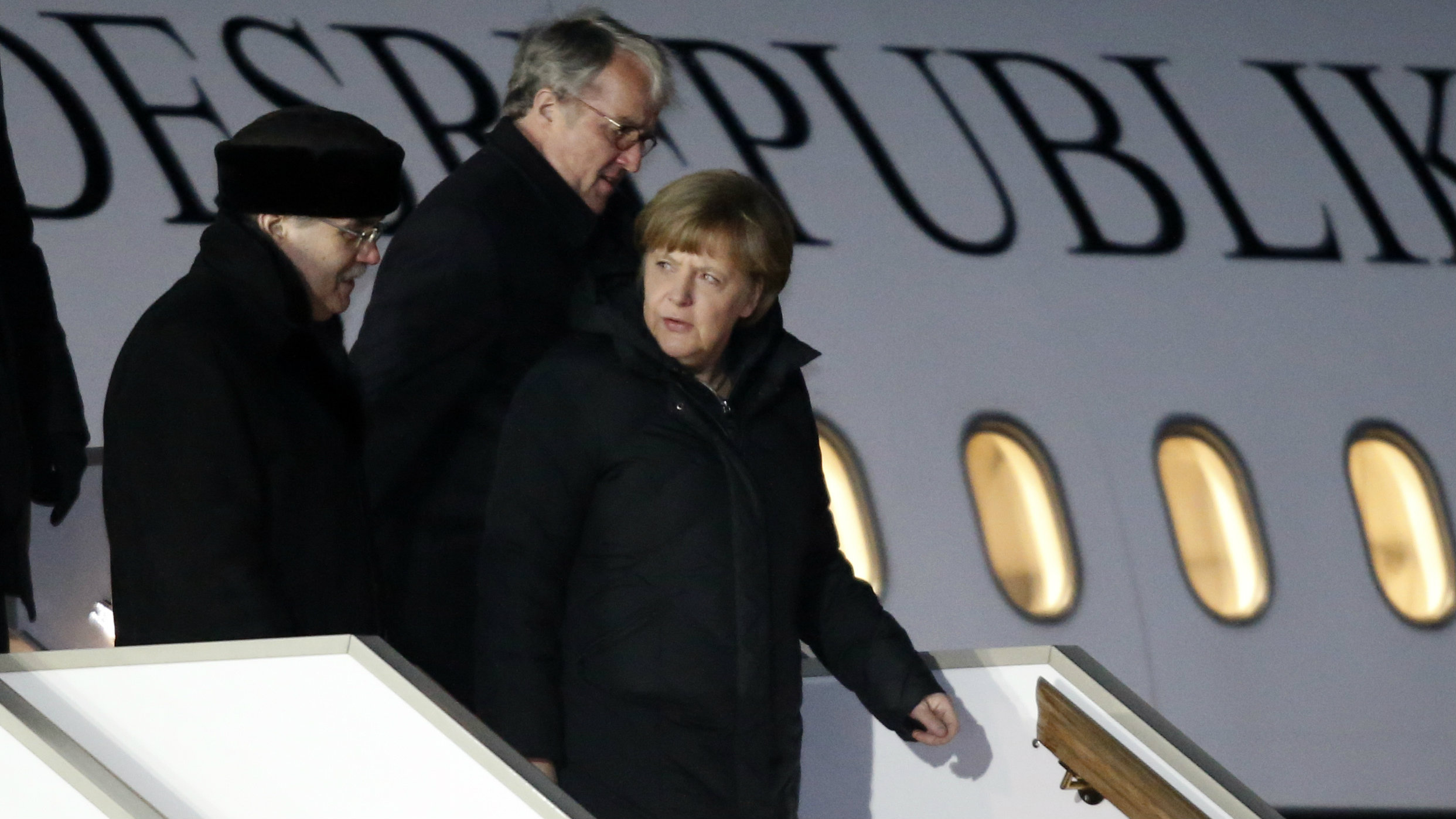 German Chancellor Angela Merkel disembarks from a plane upon her arrival at Moscow's Vnukovo airport February 6, 2015.
