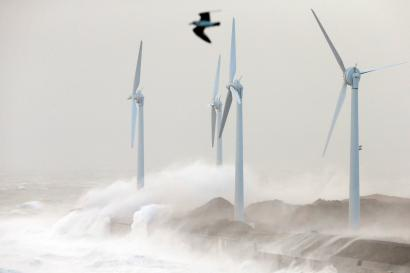 Waves crash against wind turbines during a storm named Christian that battered France at Boulogne sur Mer, northern France, October 28, 2013.